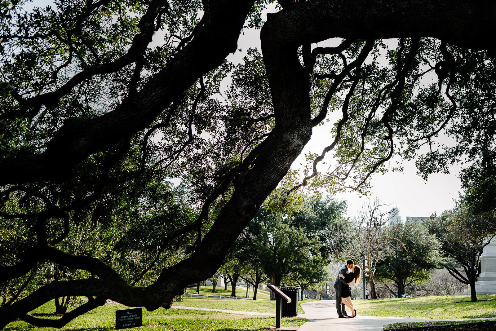 couple kissing during their austin engagement session by stephane lemaire