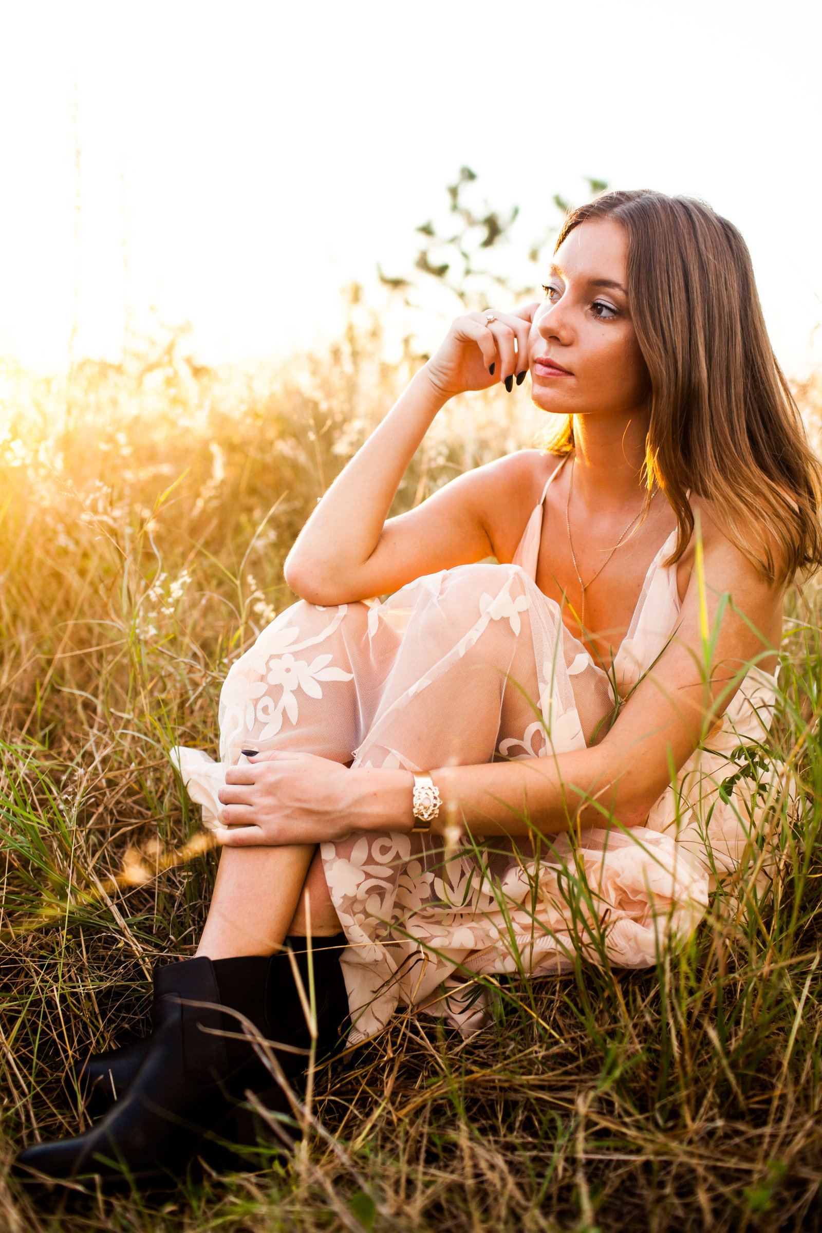 Senior pictures at sunset in field with boho dress and edgy shoes