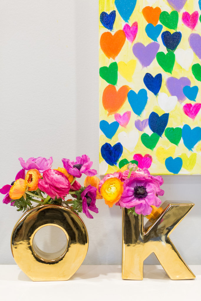 Gold O and K vases with bright flower and colorful heart painting.