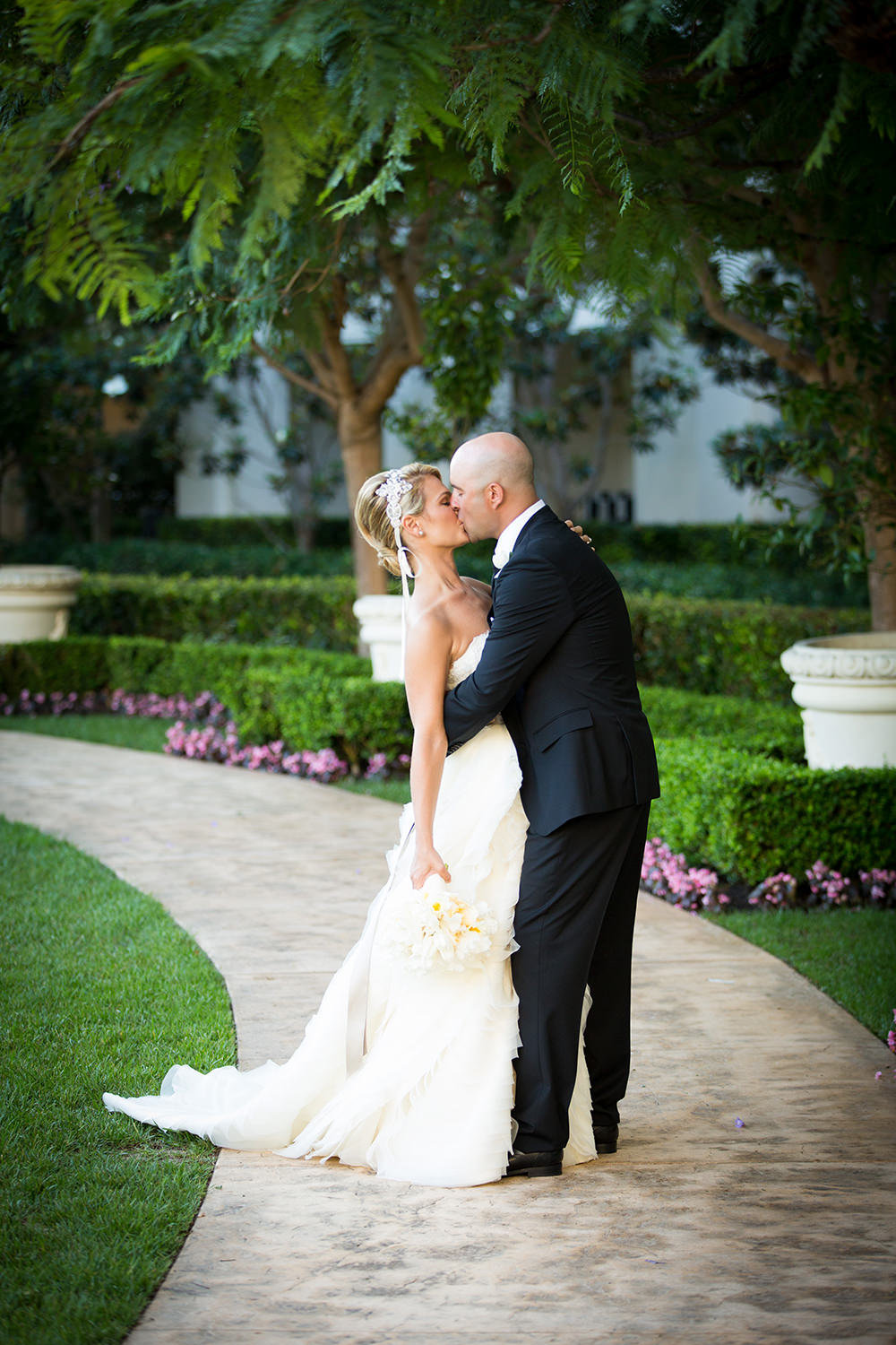 Romantic kiss on the walkway at St. Regis Monarch Beach Resort
