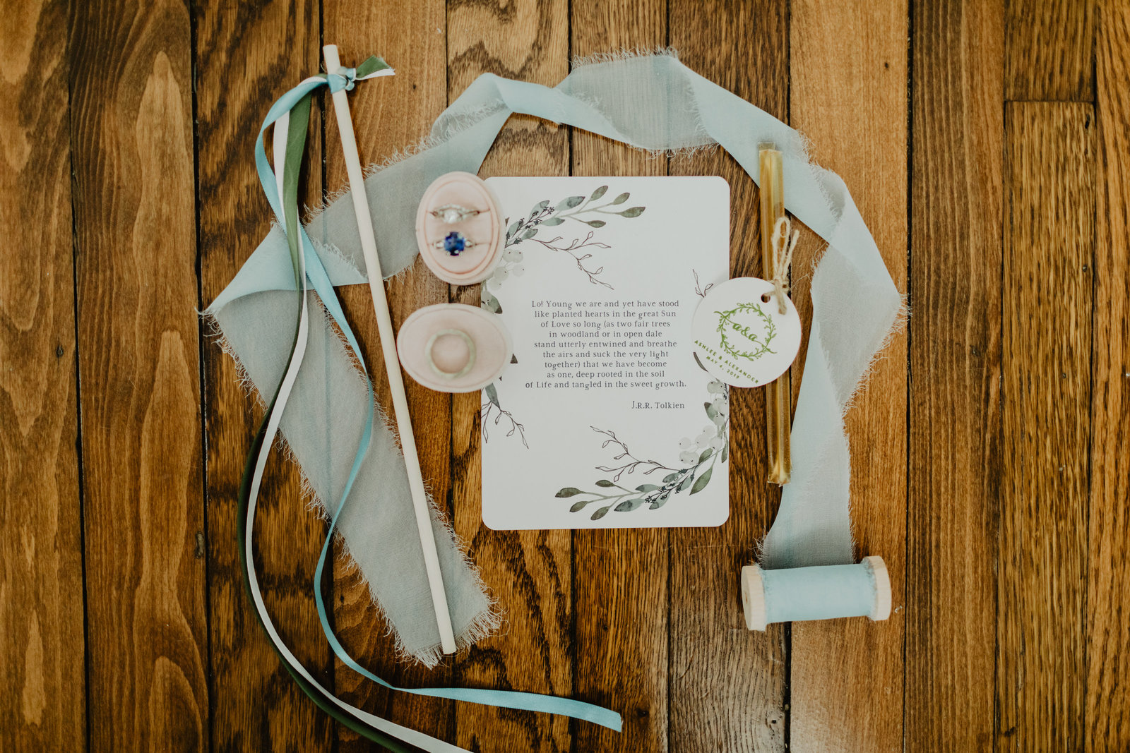 Sweet wedding day details with rings and ribbon at Long Hollow Gardens
