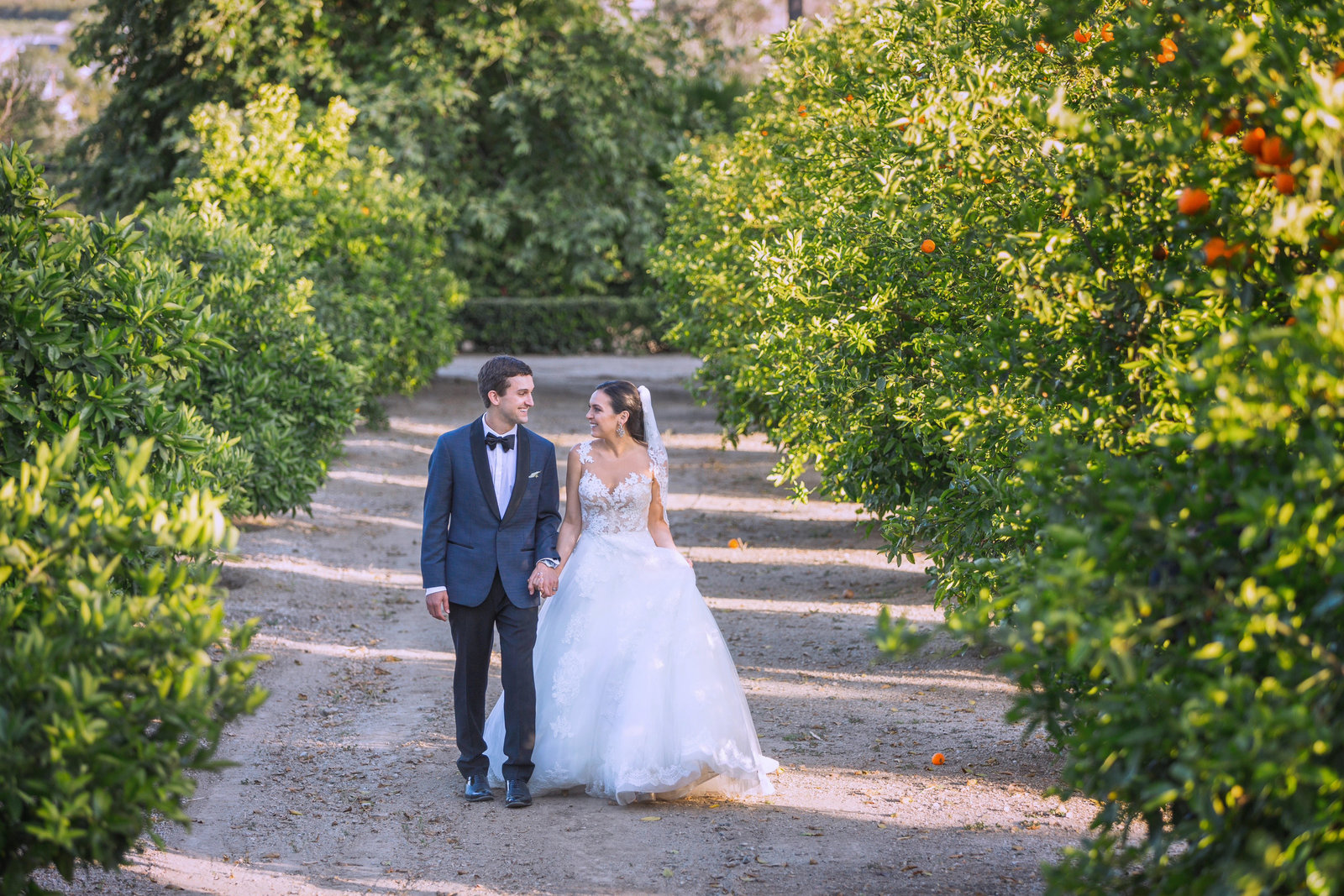 couple walking in the newhall mansion orchard