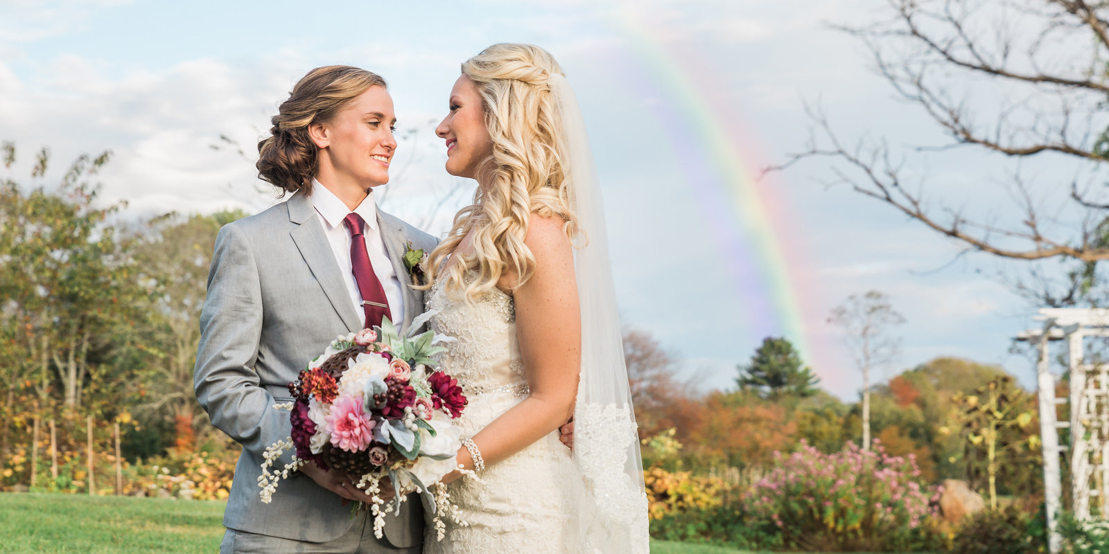 brides nat Salem Crosss Inn with rainbow behind them