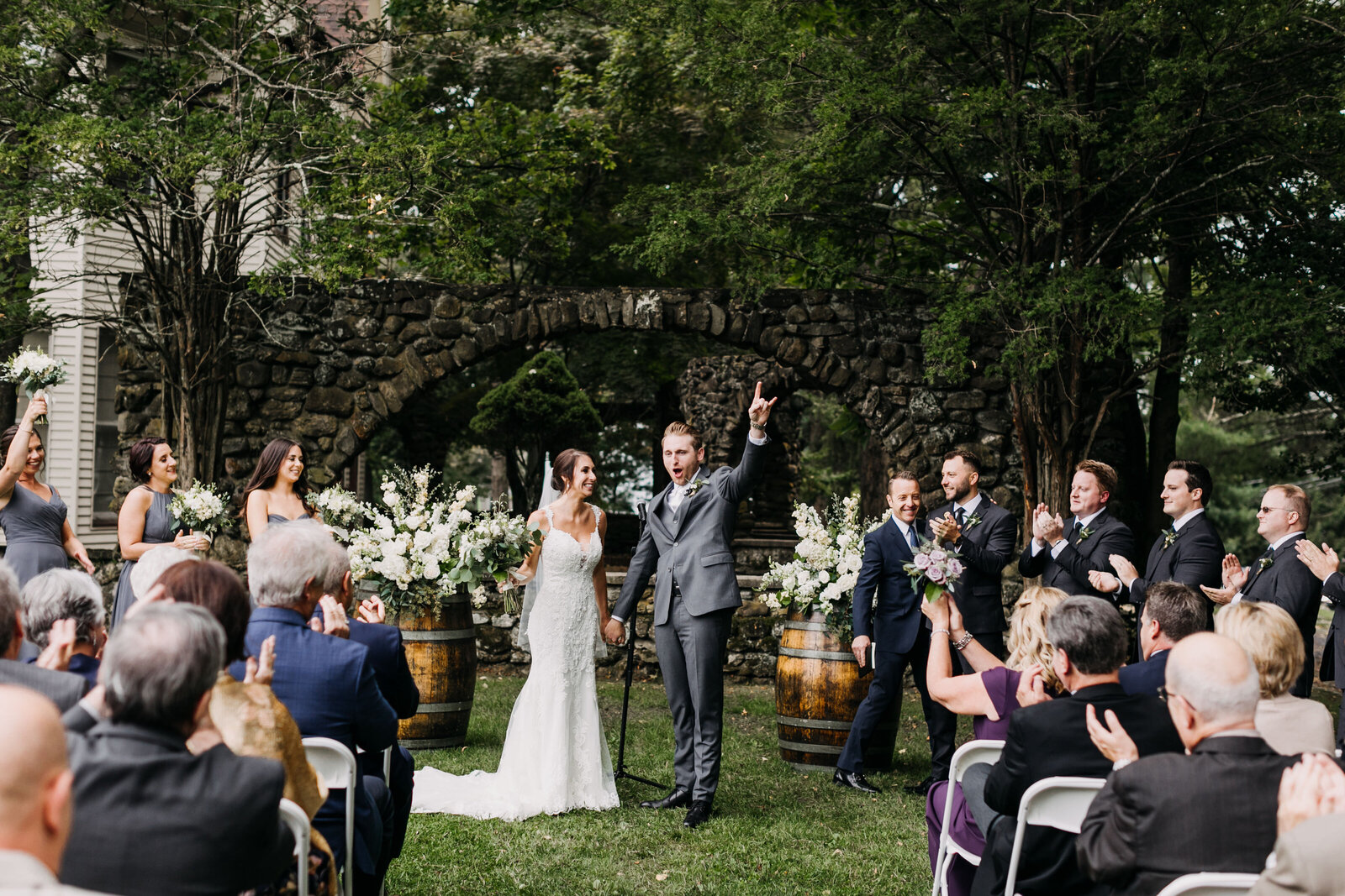 groom celebrating ceremony at winery