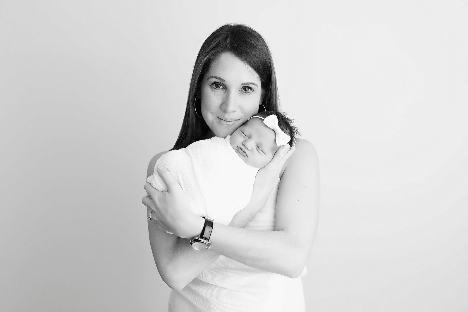 Black and white photo of mother and newborn