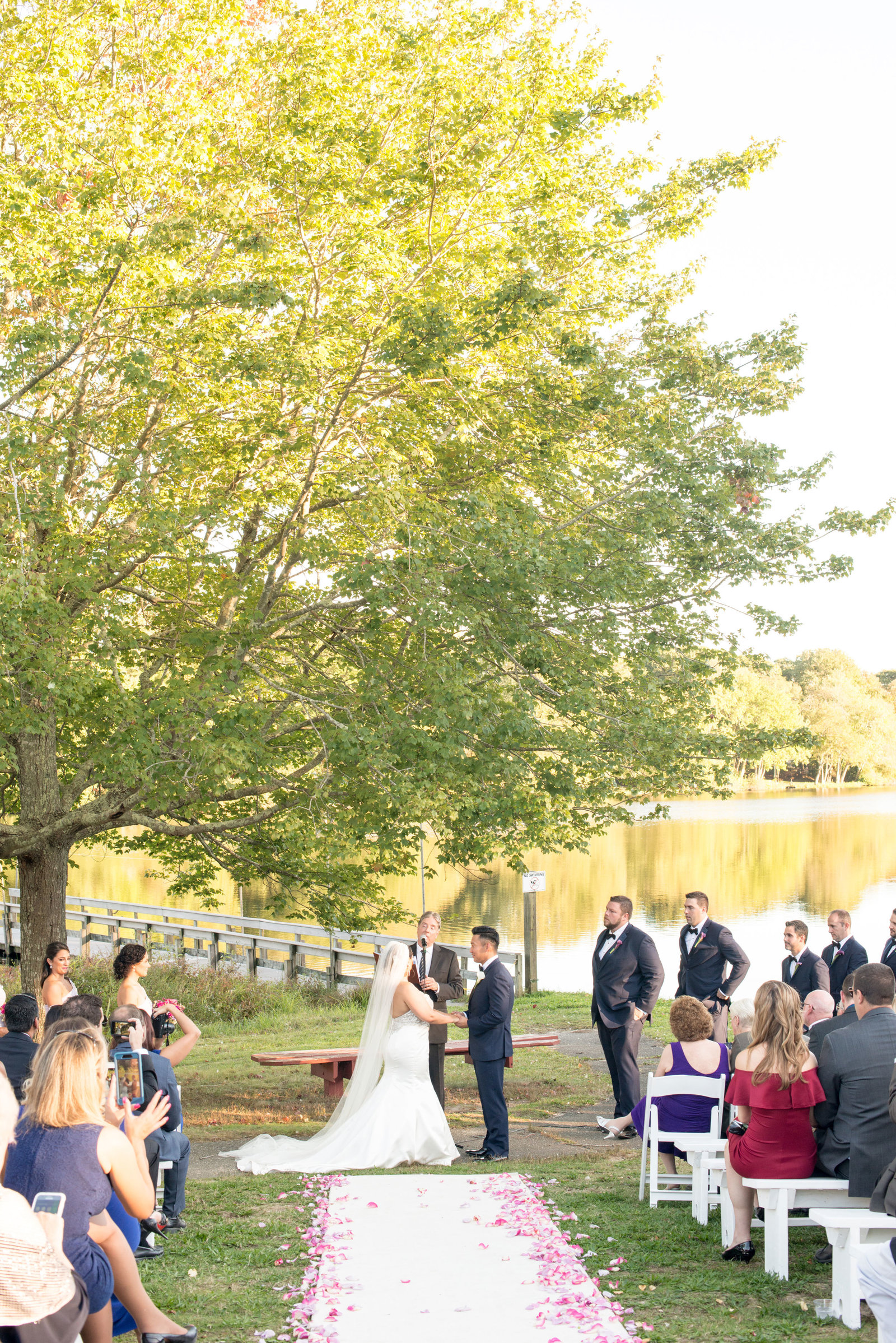 Bride and groom exchanging vows at Camp Pa-Qua-Tuck