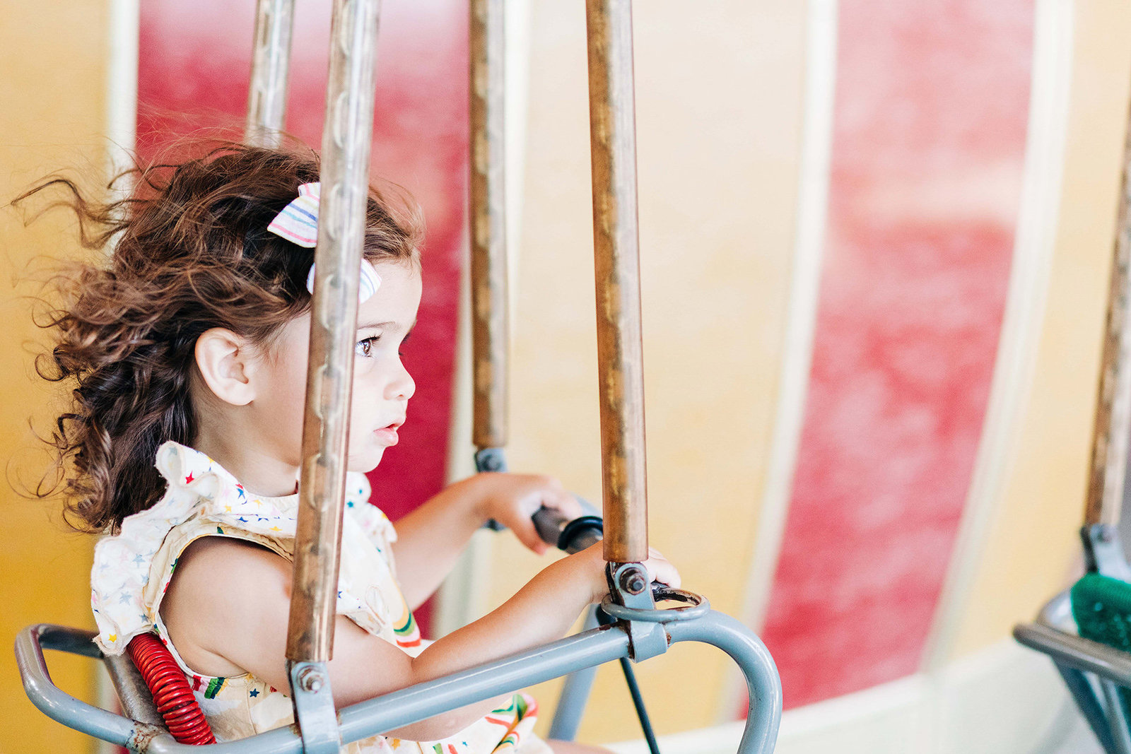 Portrait of a little girl at an amusement park