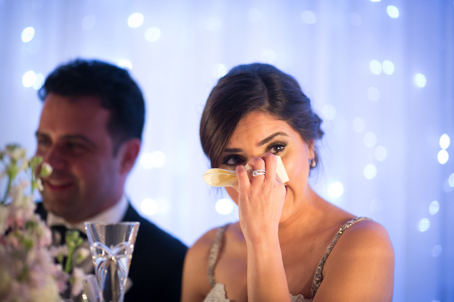 A bride tears up during her fathers speech