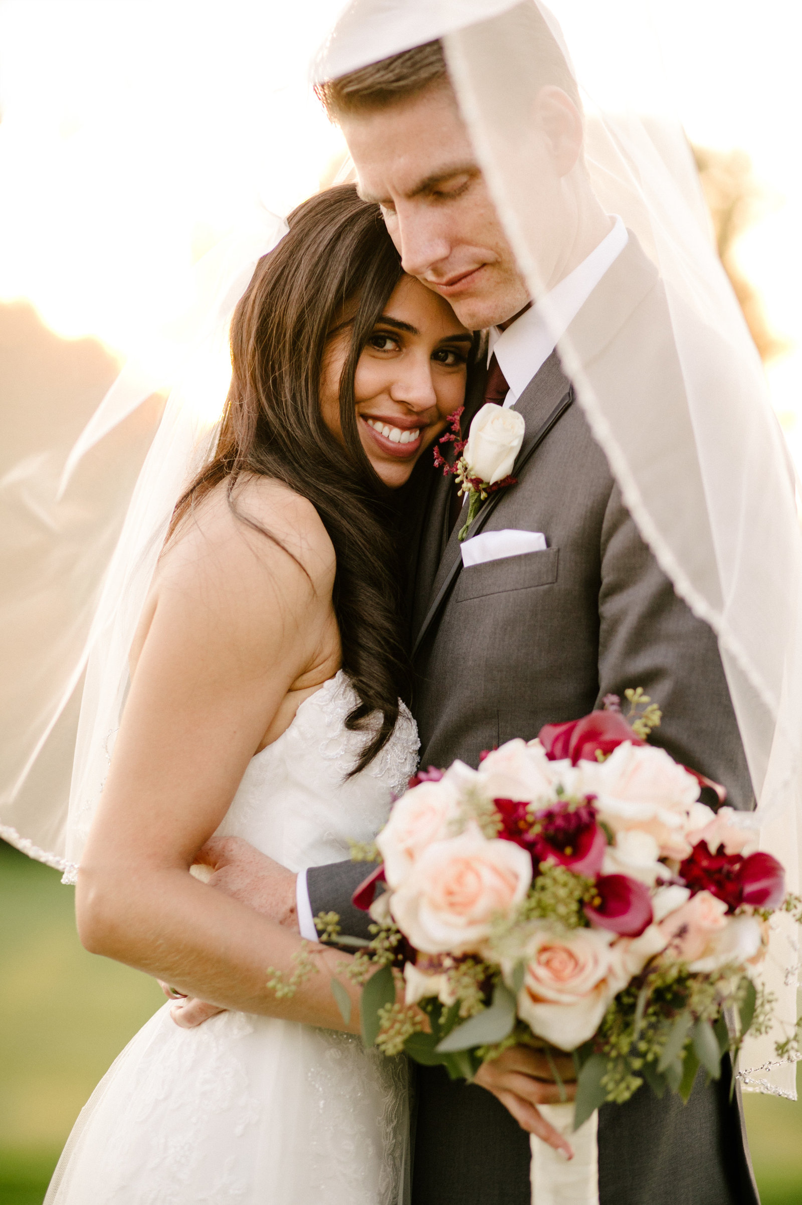 bride and groom holding each other at red hill country club in rancho cucamonga