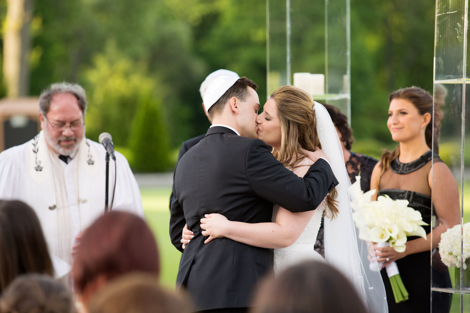 "bride and groom kissing ""I do"" at Engineers Country Club"