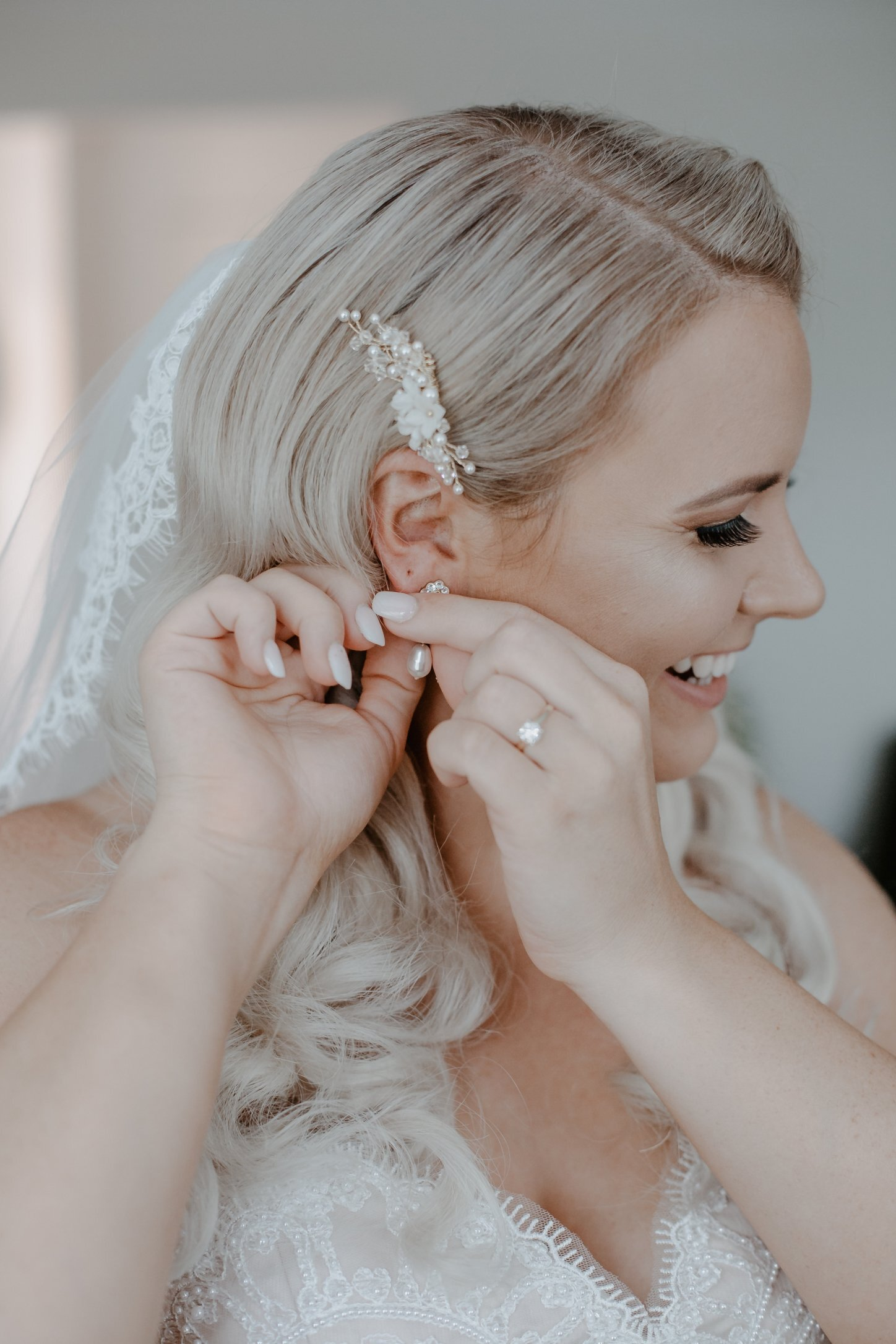 Bride Hayley wearing pearl crystal and flower bespoke comb in gold5