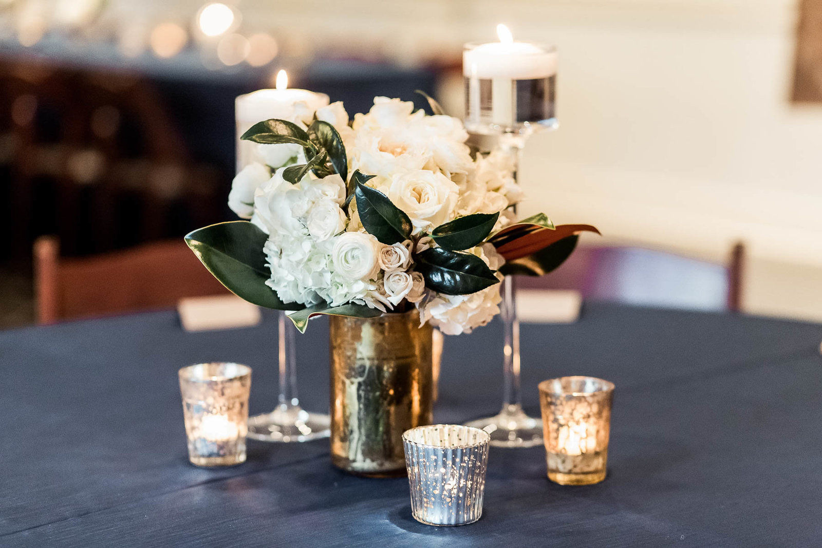 Beautiful floral centerpieces are on each table, Coleman Hall, Mt Pleasant, South Carolina