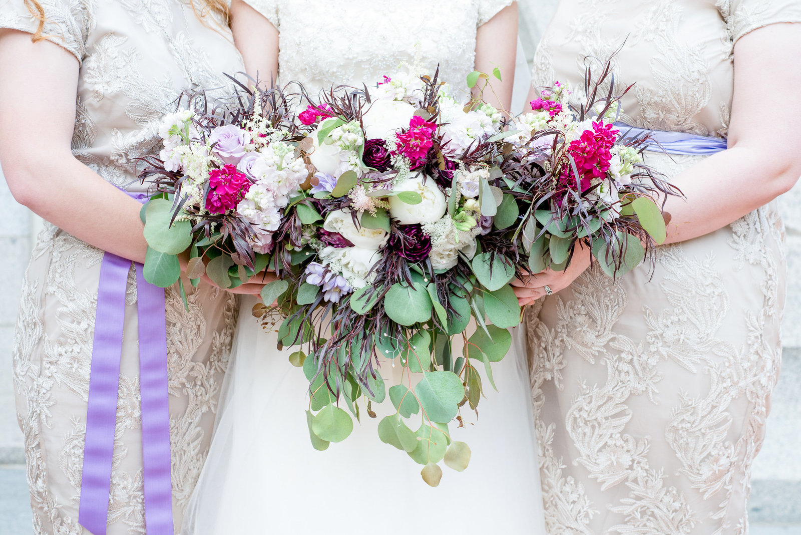 Bridesmaids holding bouquets of flowers at Salt Lake Temple Wedding