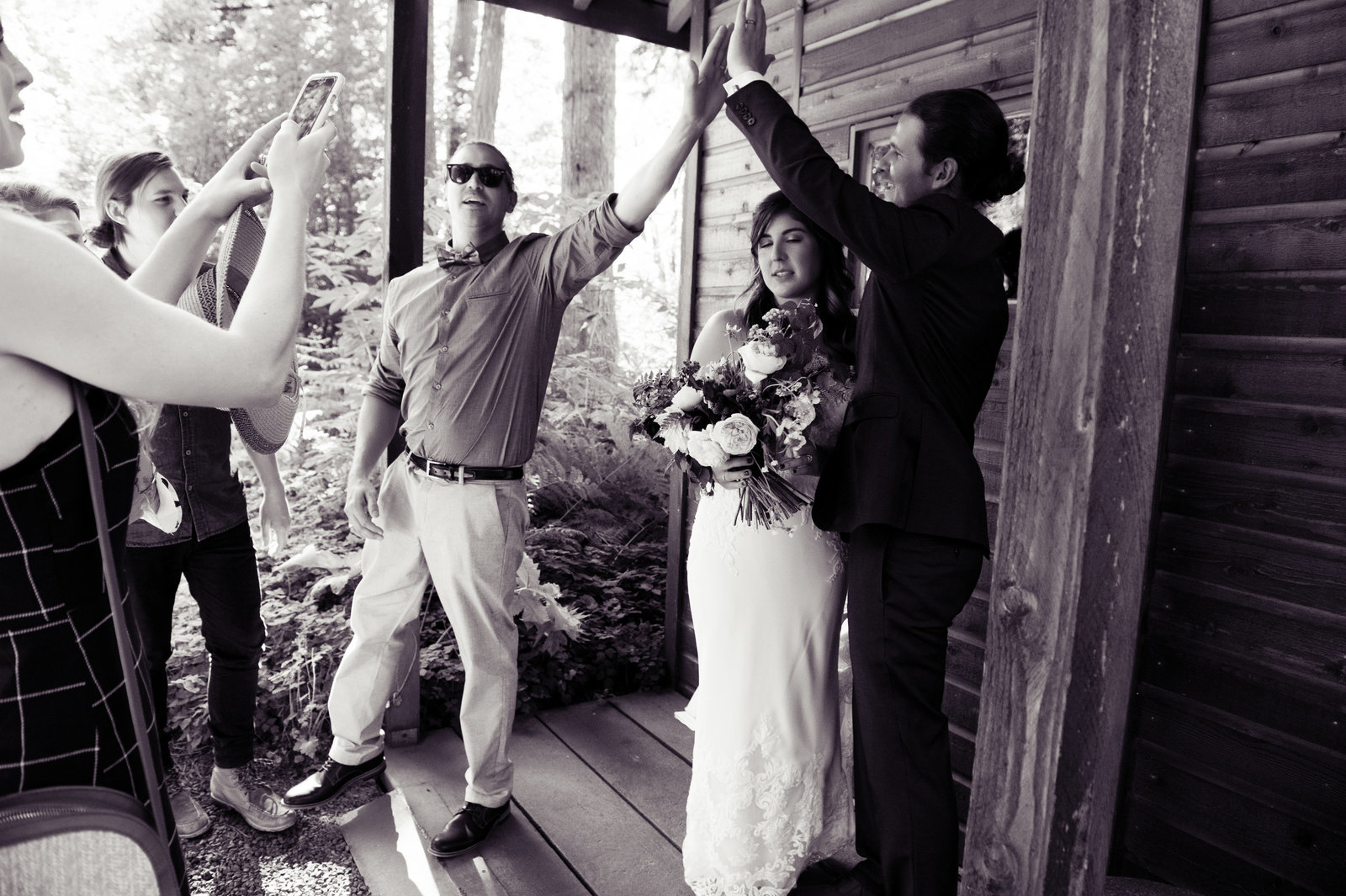guests give the groom a high five after the wedding