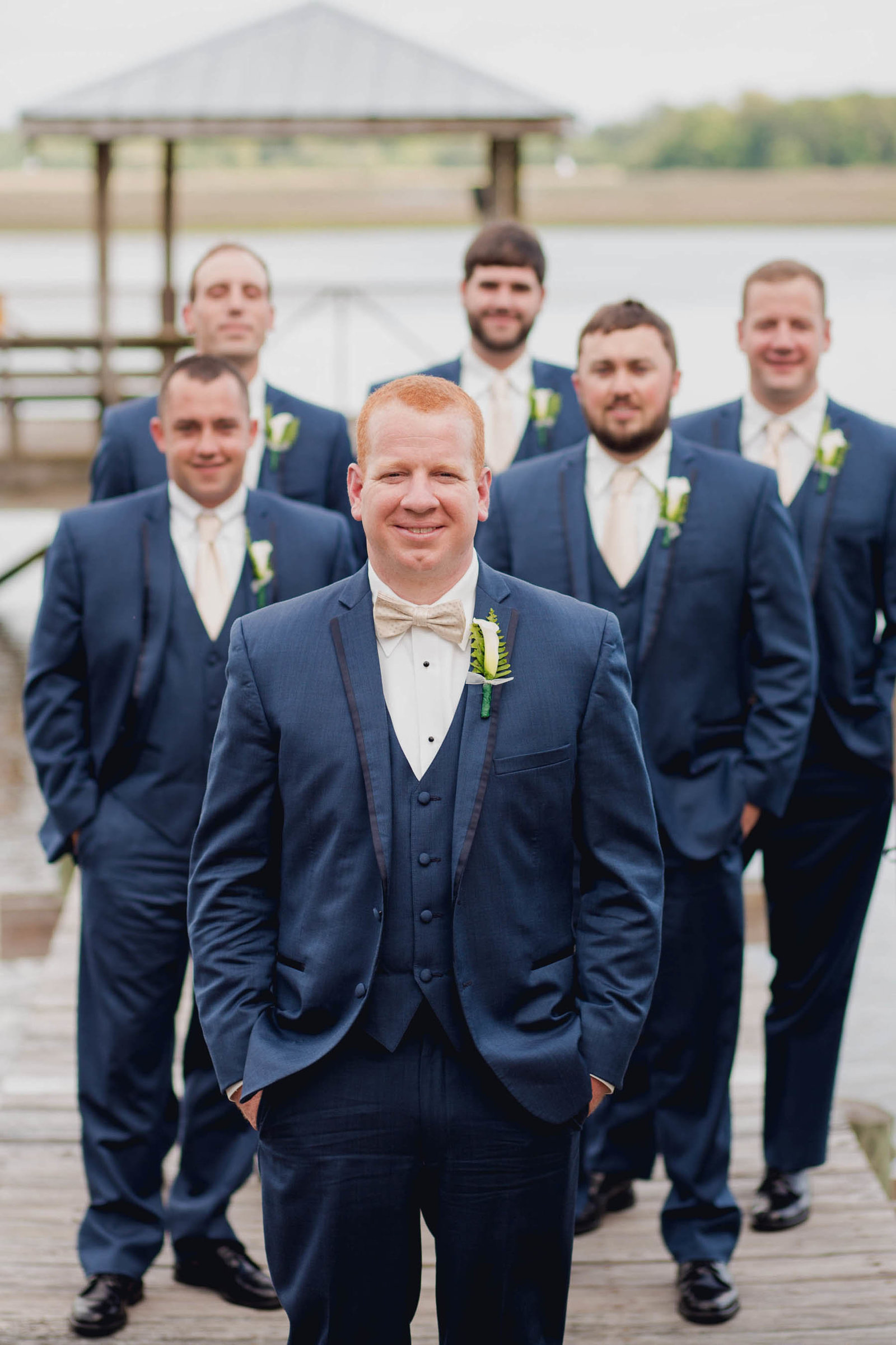 Groom and groomsmen stand on dock, Old Wide Awake Plantation, Charleston, South Carolina