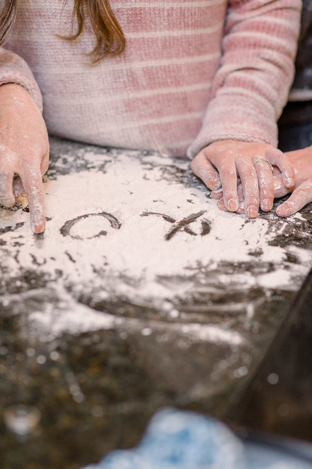 Writing cute notes in the flour captured by Staci Addison Photography