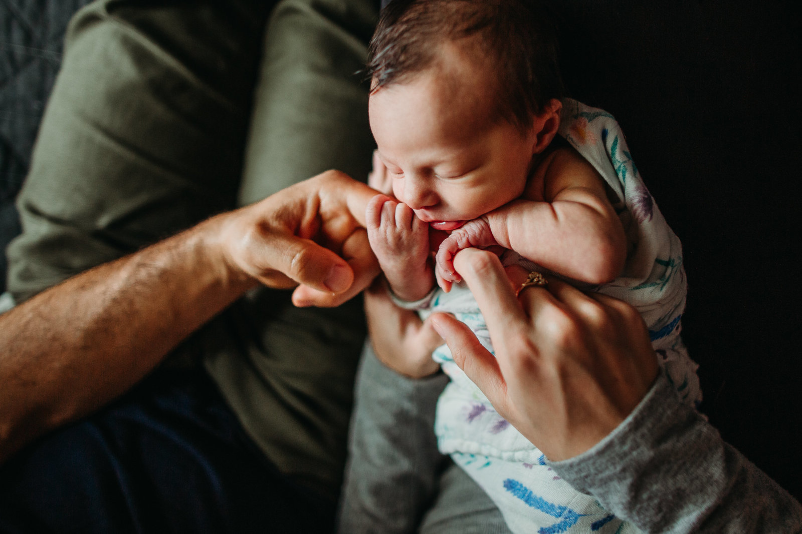 brookline newborn clutches mom and dads fingers during photoshoot