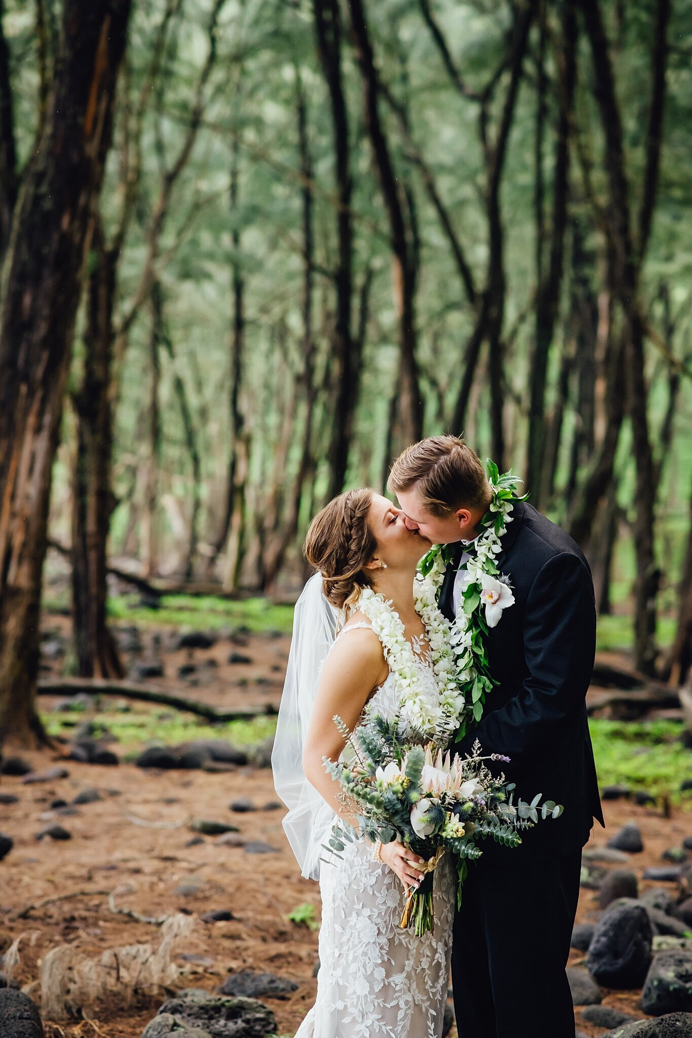 couples kiss in forest
