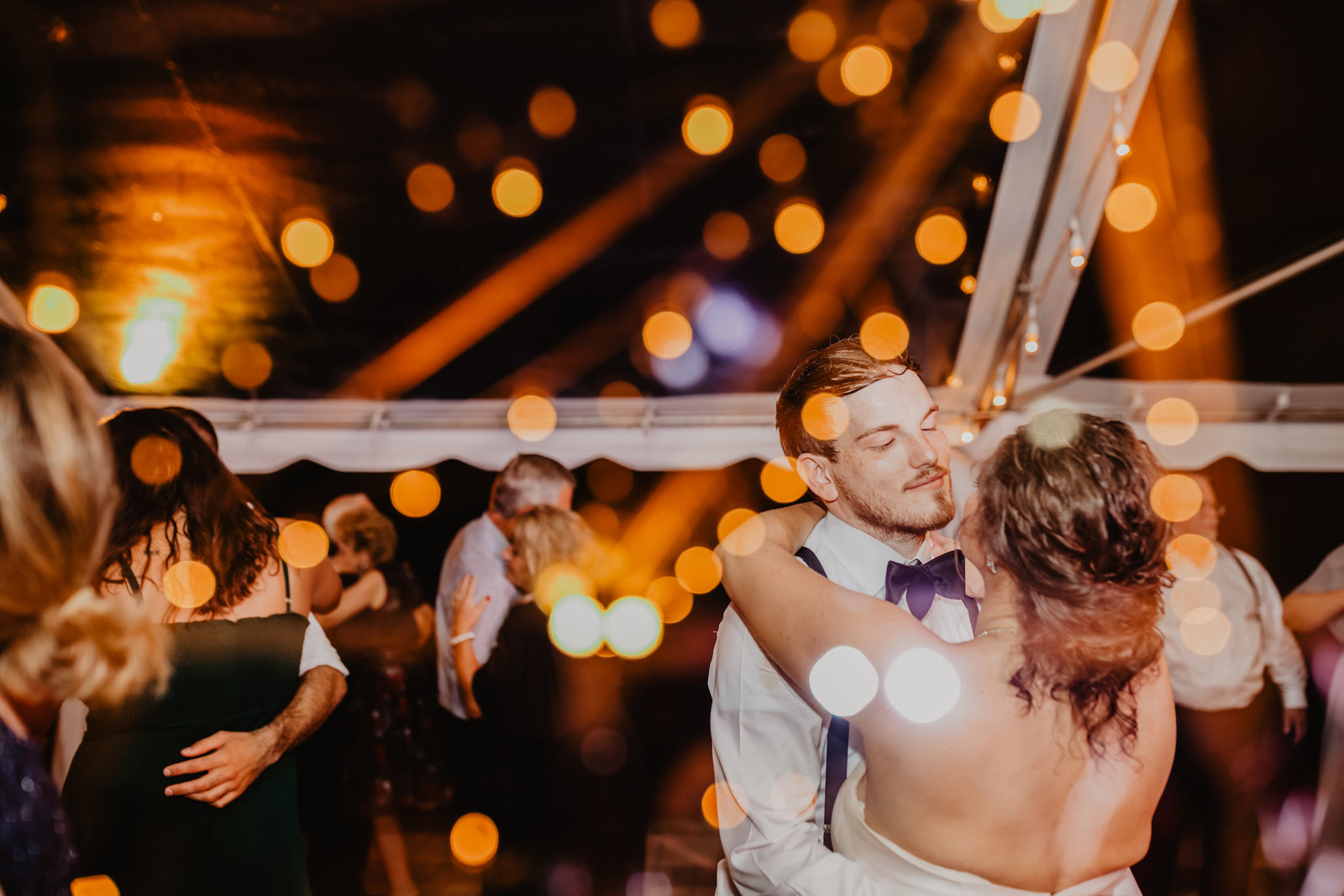 Groom dancing with Bride during their reception at Overlook Manor Wind River