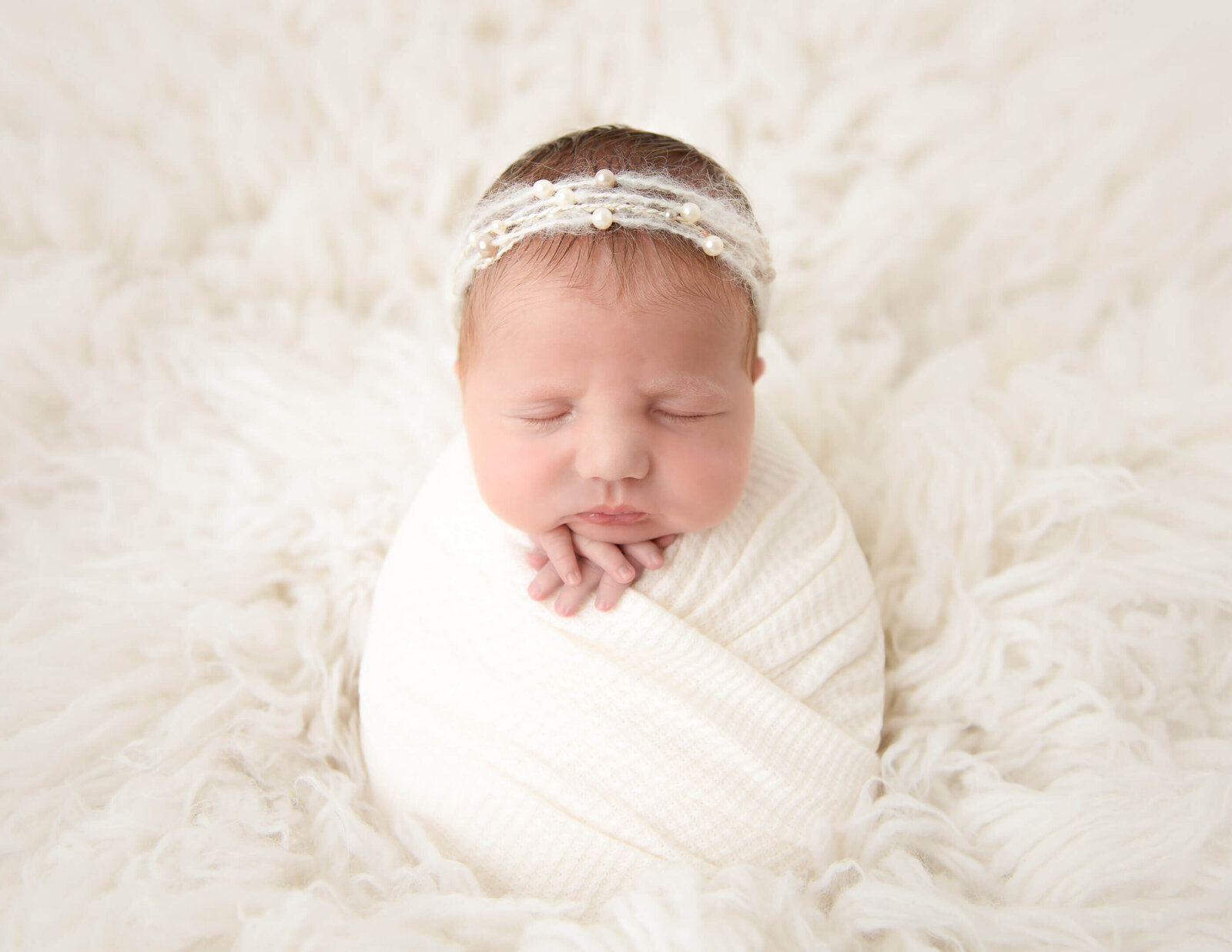 Sweet sleeping newborn girl in our Rochester NY studio.