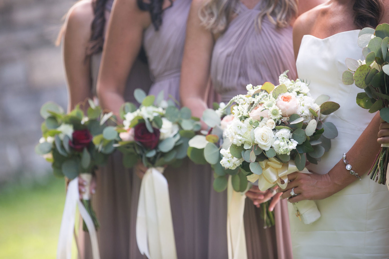 bride and bridesmaids with their bouquets at Glen Island Harbor Club