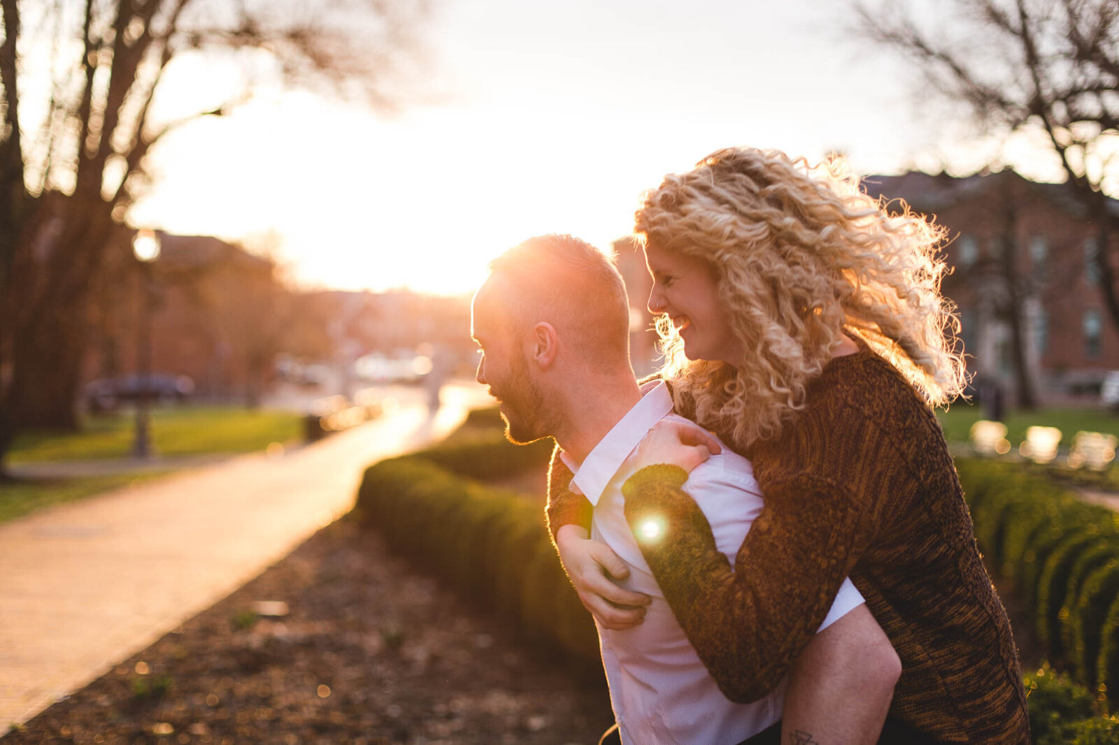 engaged couple piggy back ride in golden hour ohio photographer