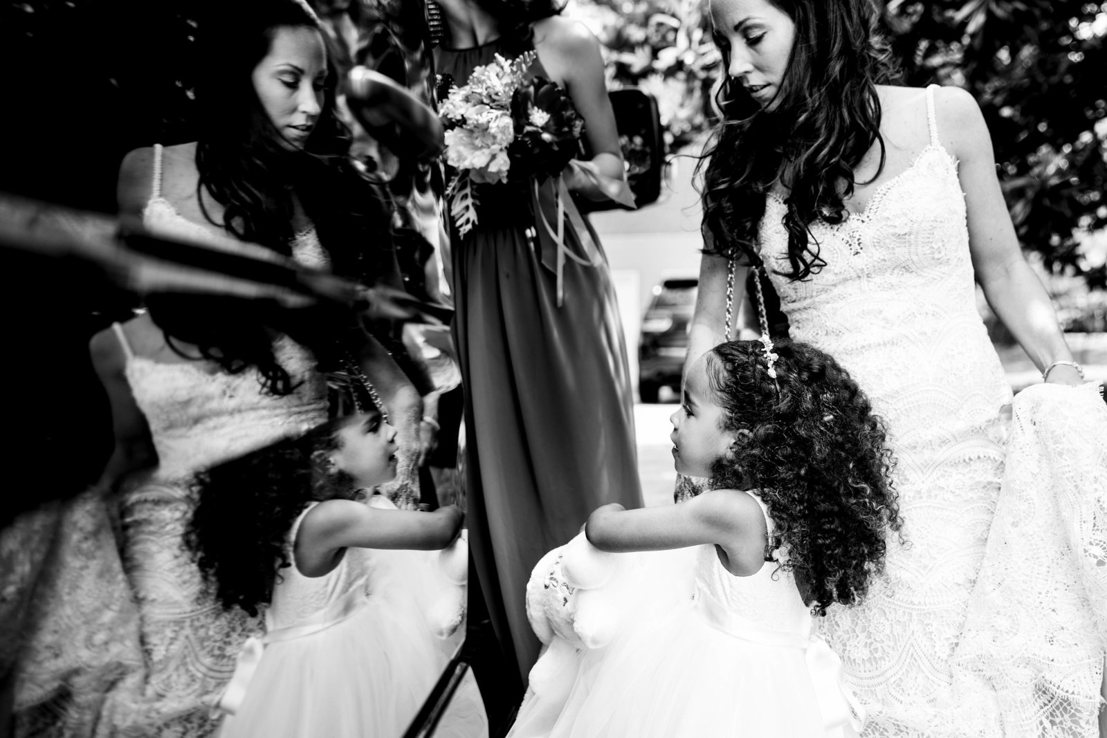 bride and flower girl getting into limo