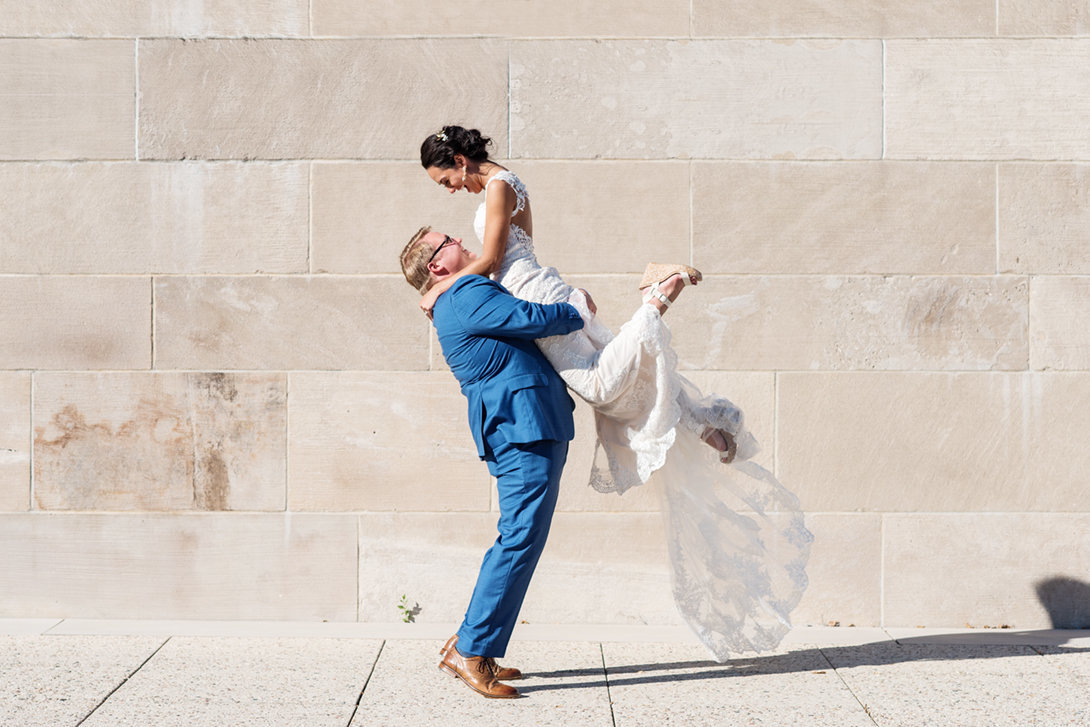Bride jumping into grooms arms
