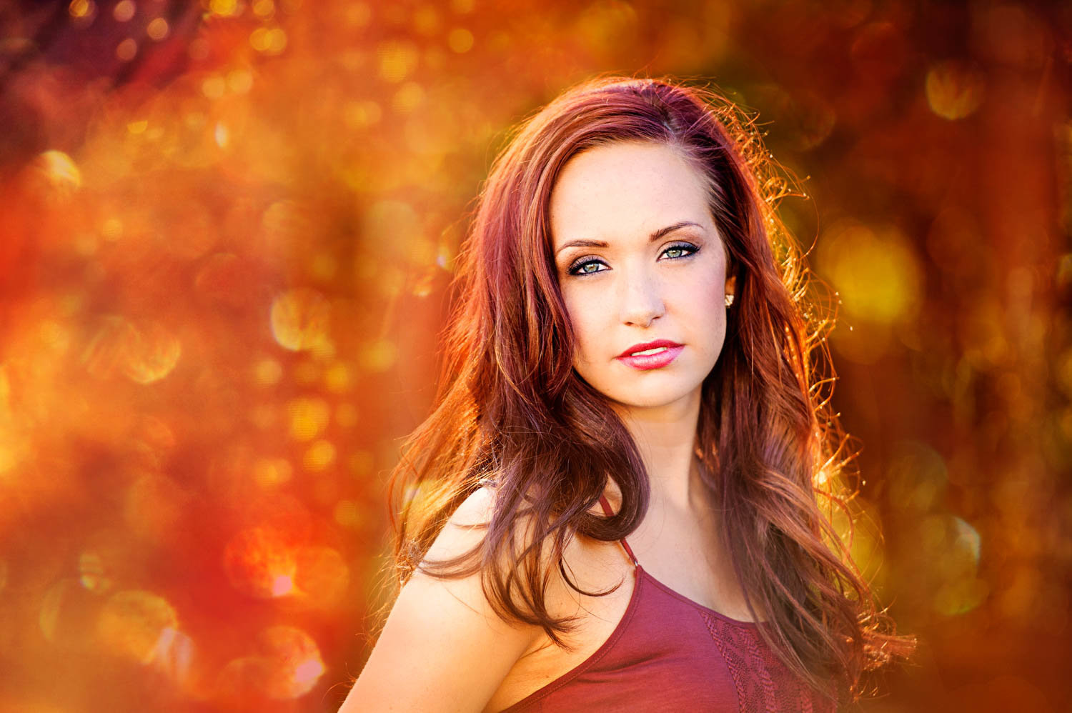 Sunset senior picture of girl with red hair
