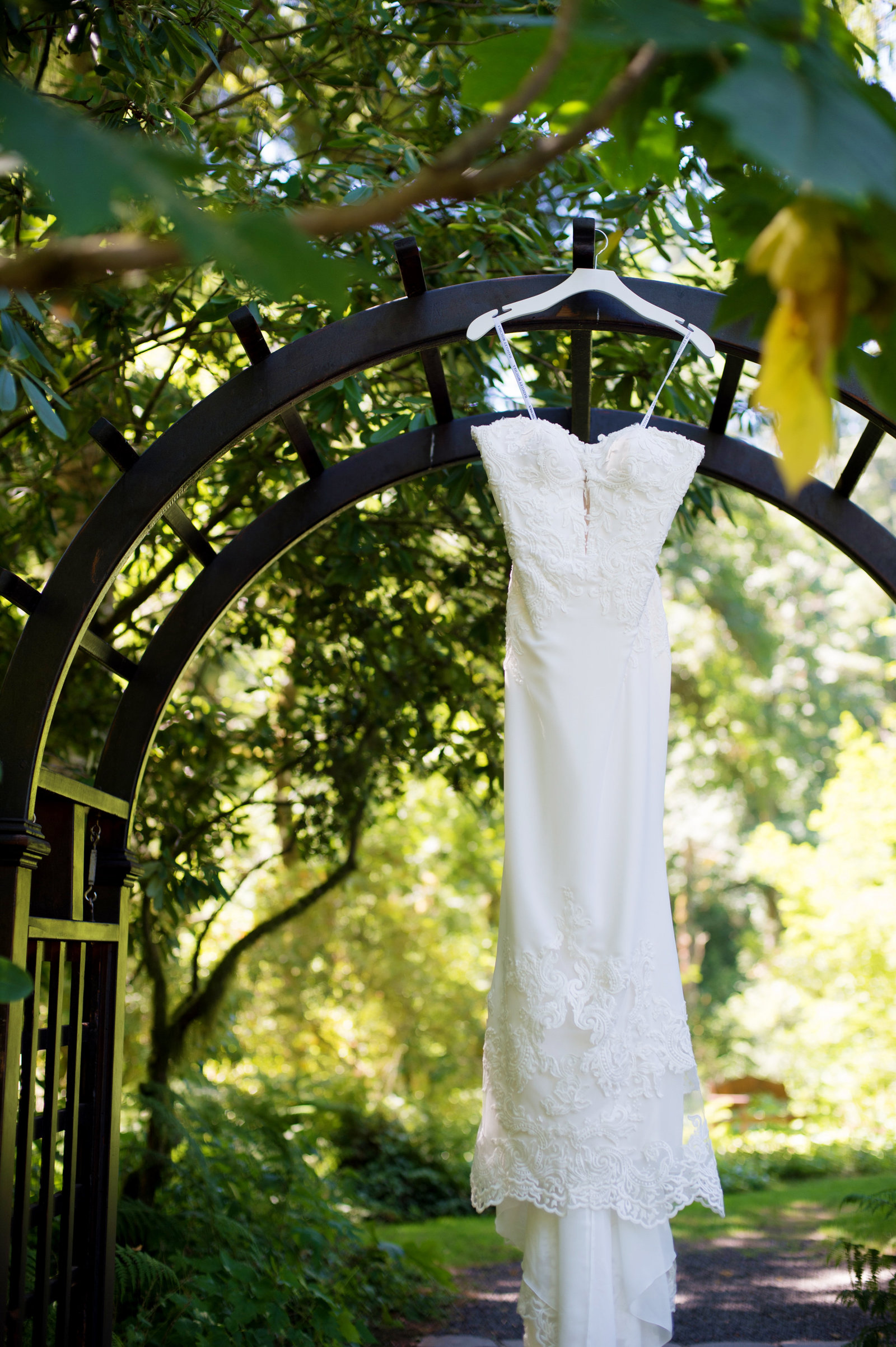 wedding dress hangs from an outdoor archway at bridal veil lakes