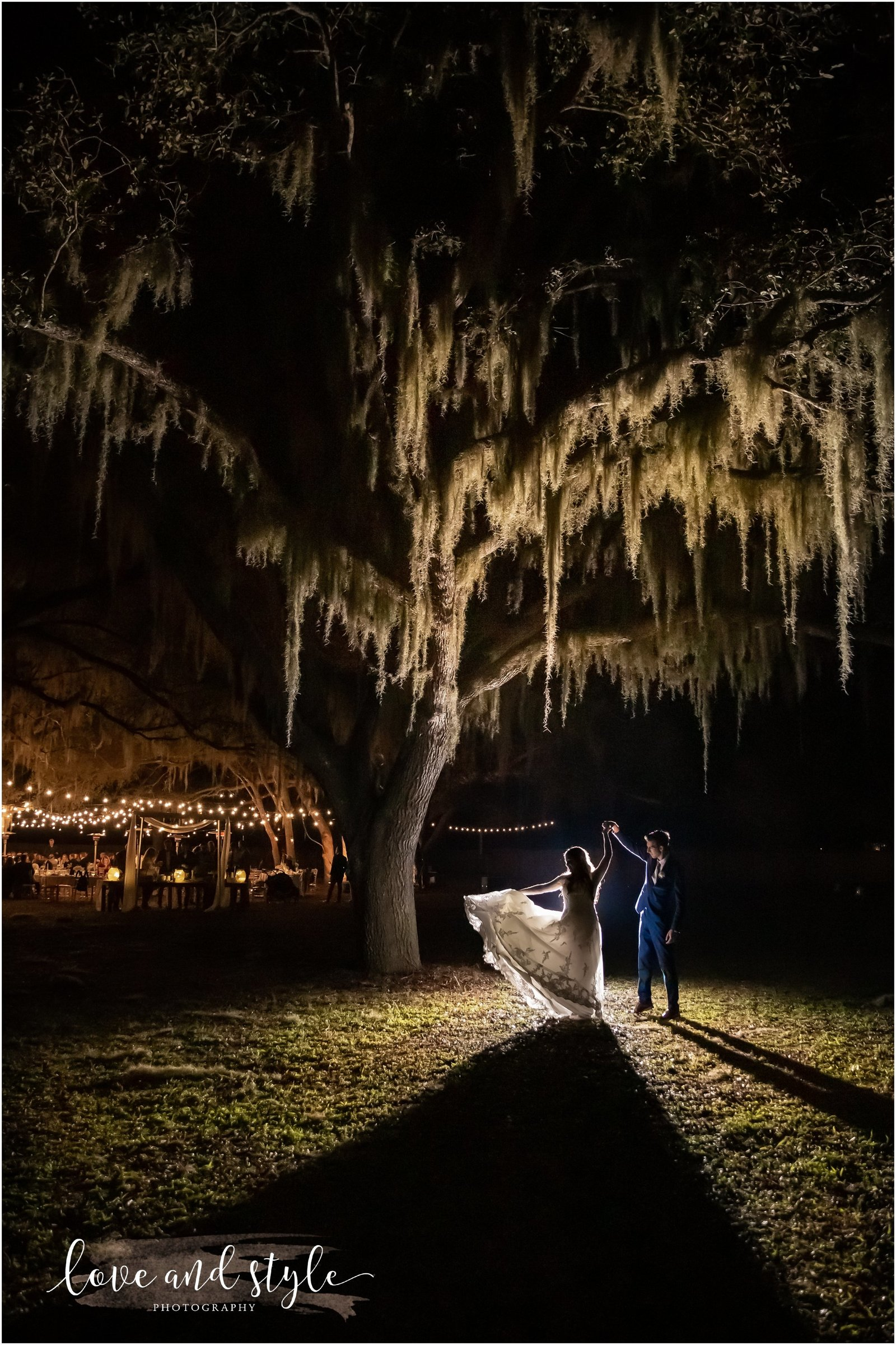 Bride and Groom Dancing under an Oak tree after dark with backlight  at The Barn at Chapel Creek Wedding venue in Venice, Florida