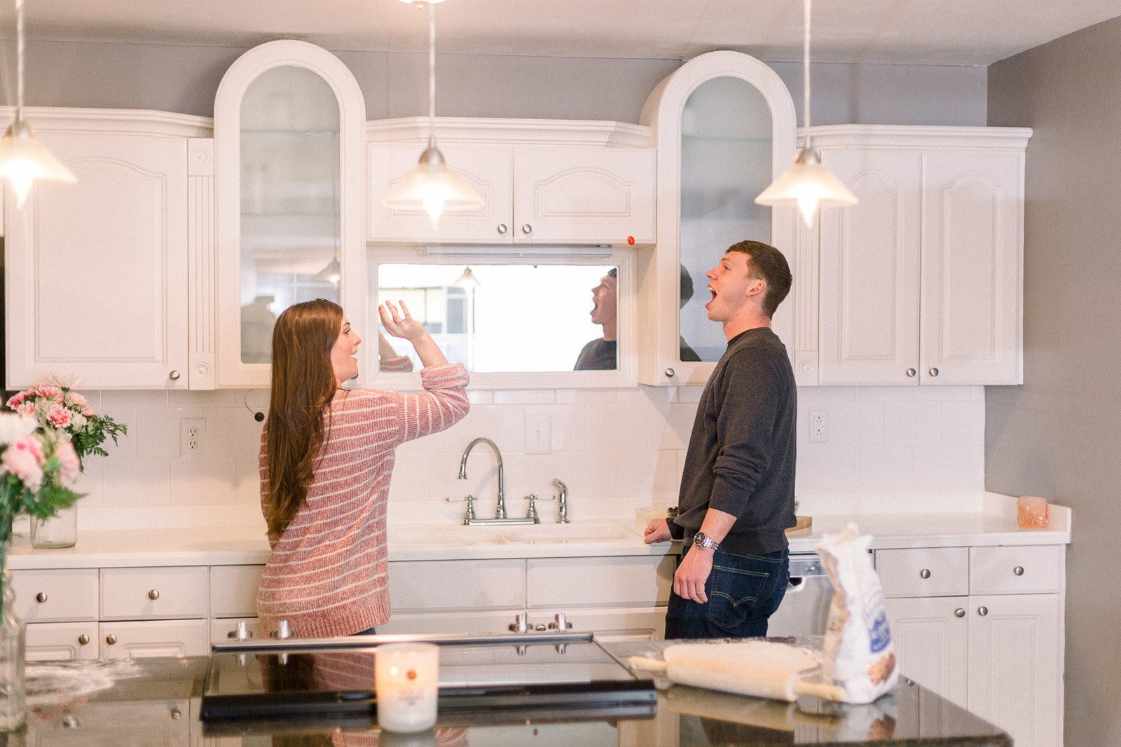 Couple having fun while making dinner captured by Staci Addison Photography
