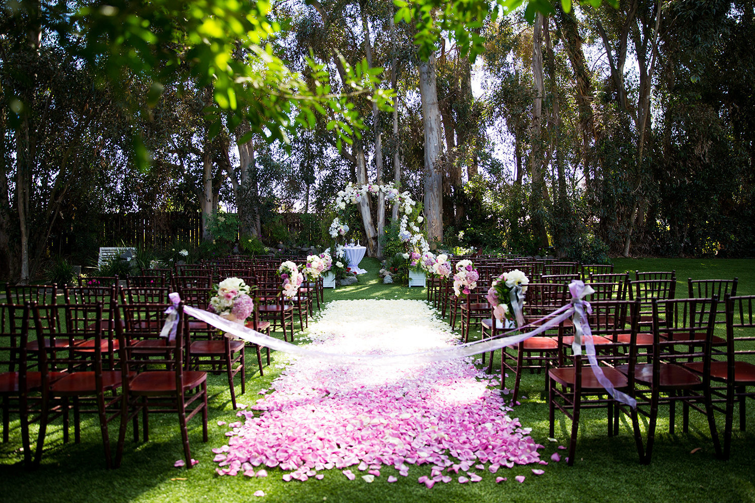 Flower petal runner for a colorful wedding ceremony site at Twin Oaks Garden Estate in San Diego