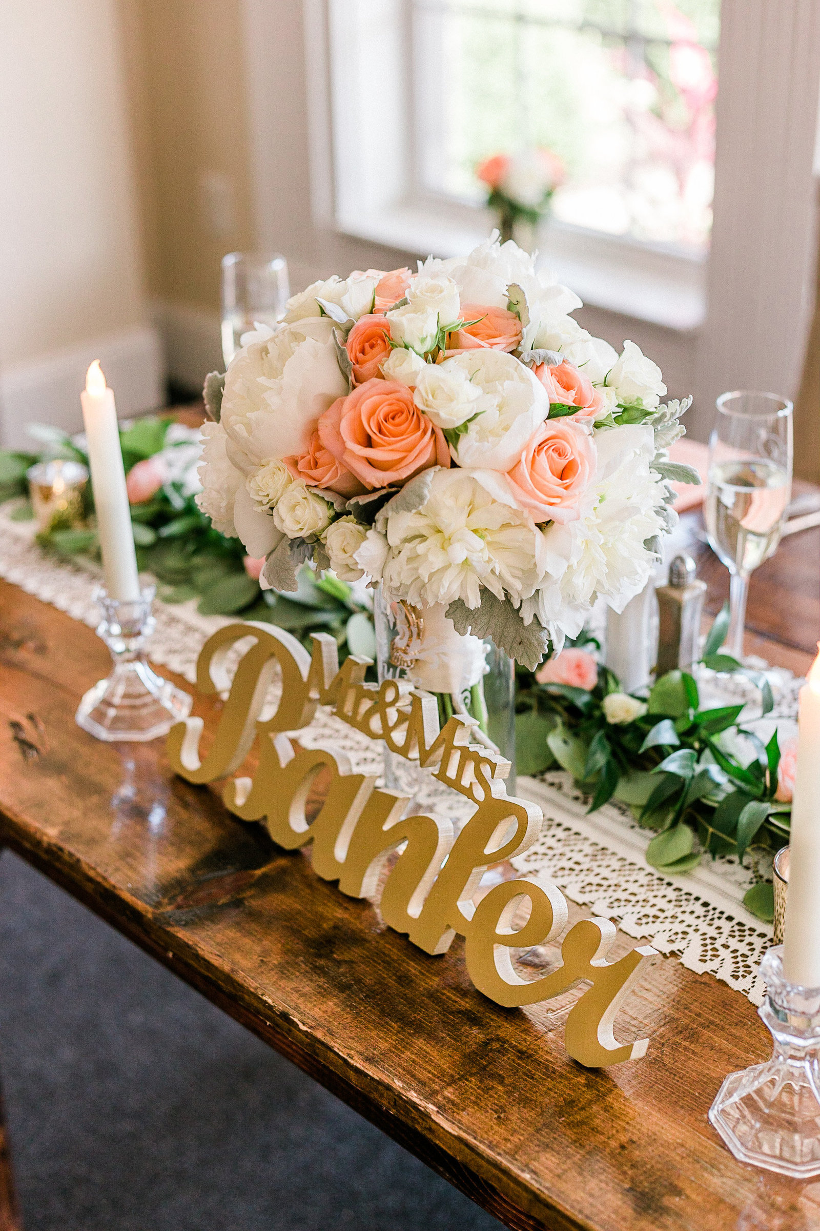 Farm style sweetheart table with lace runner