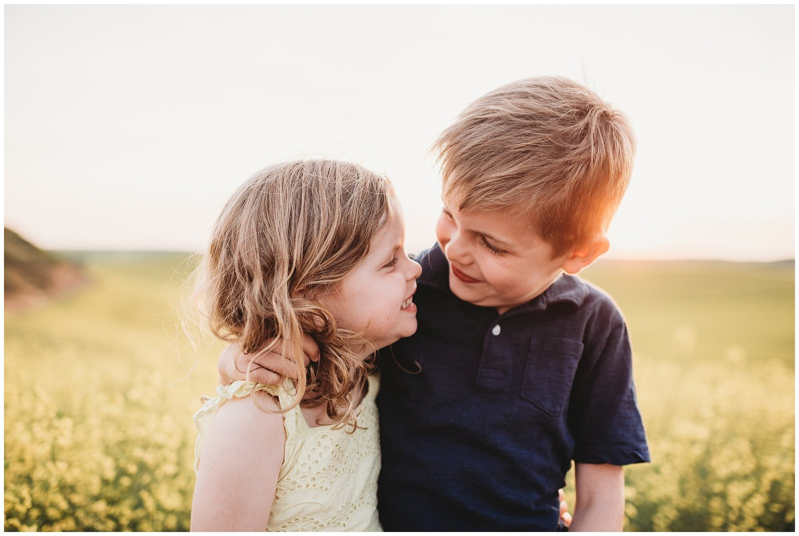 brother and sister giggling Emily Ann Photography Seattle Family Photographer