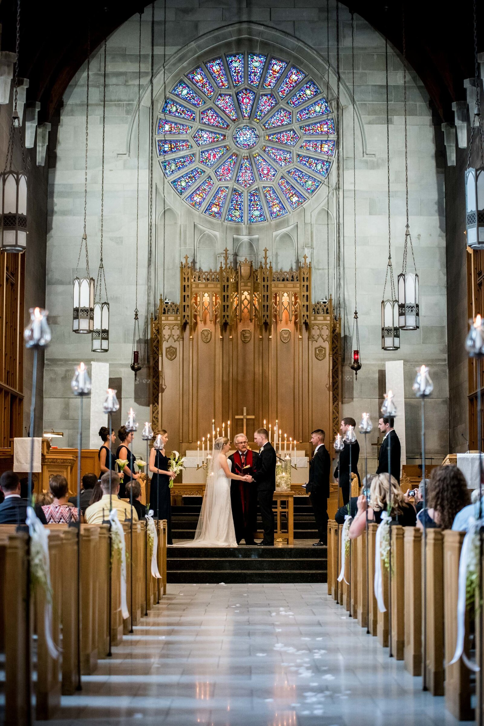 wedding-st-charles-church-aisle-ceremony