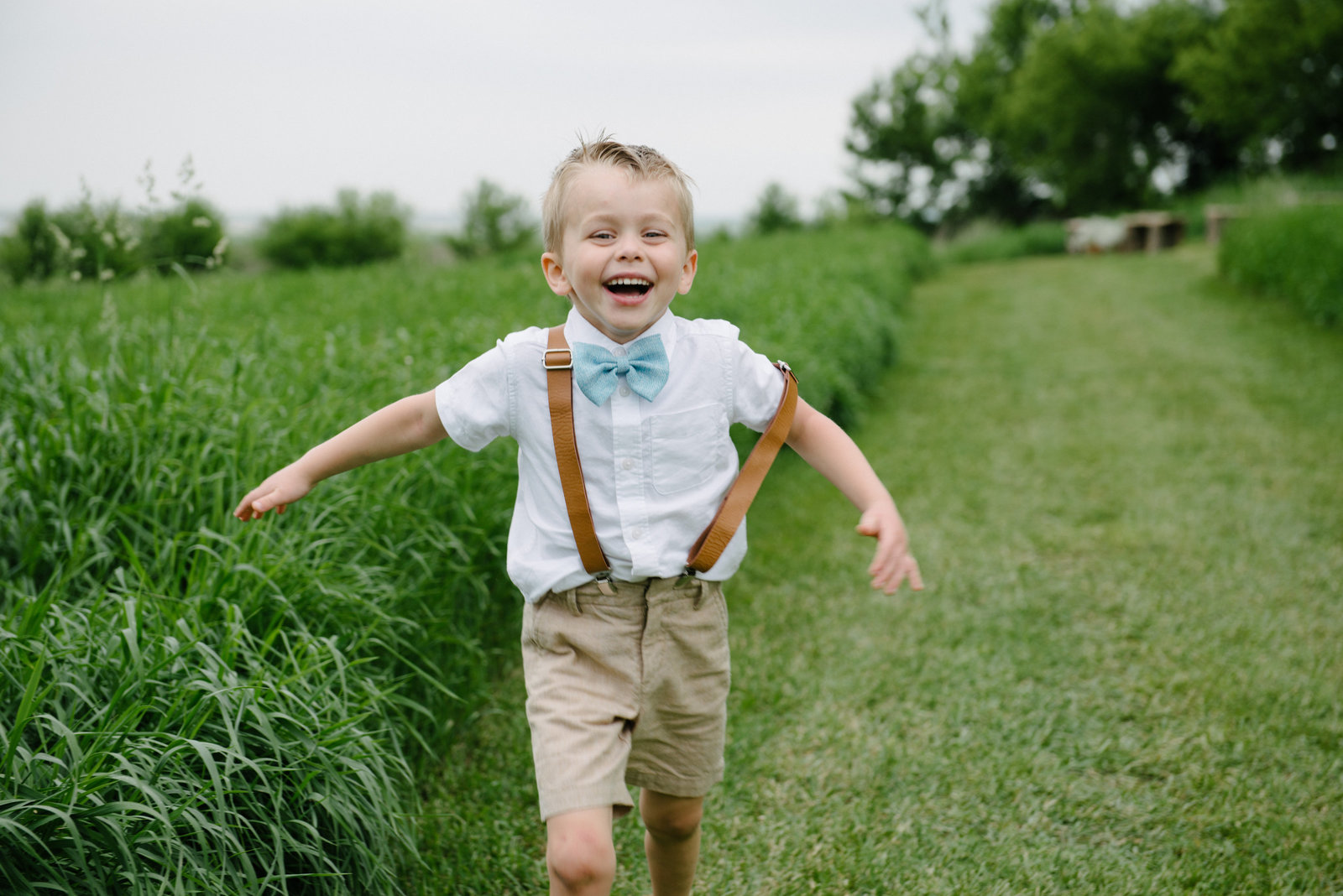 ring bearer running and laughing