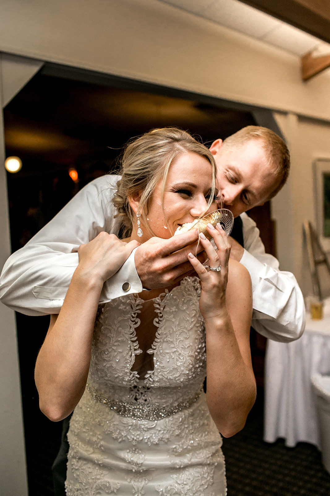 Des Moines Iowa couple  eating their cake at their wedding reception.