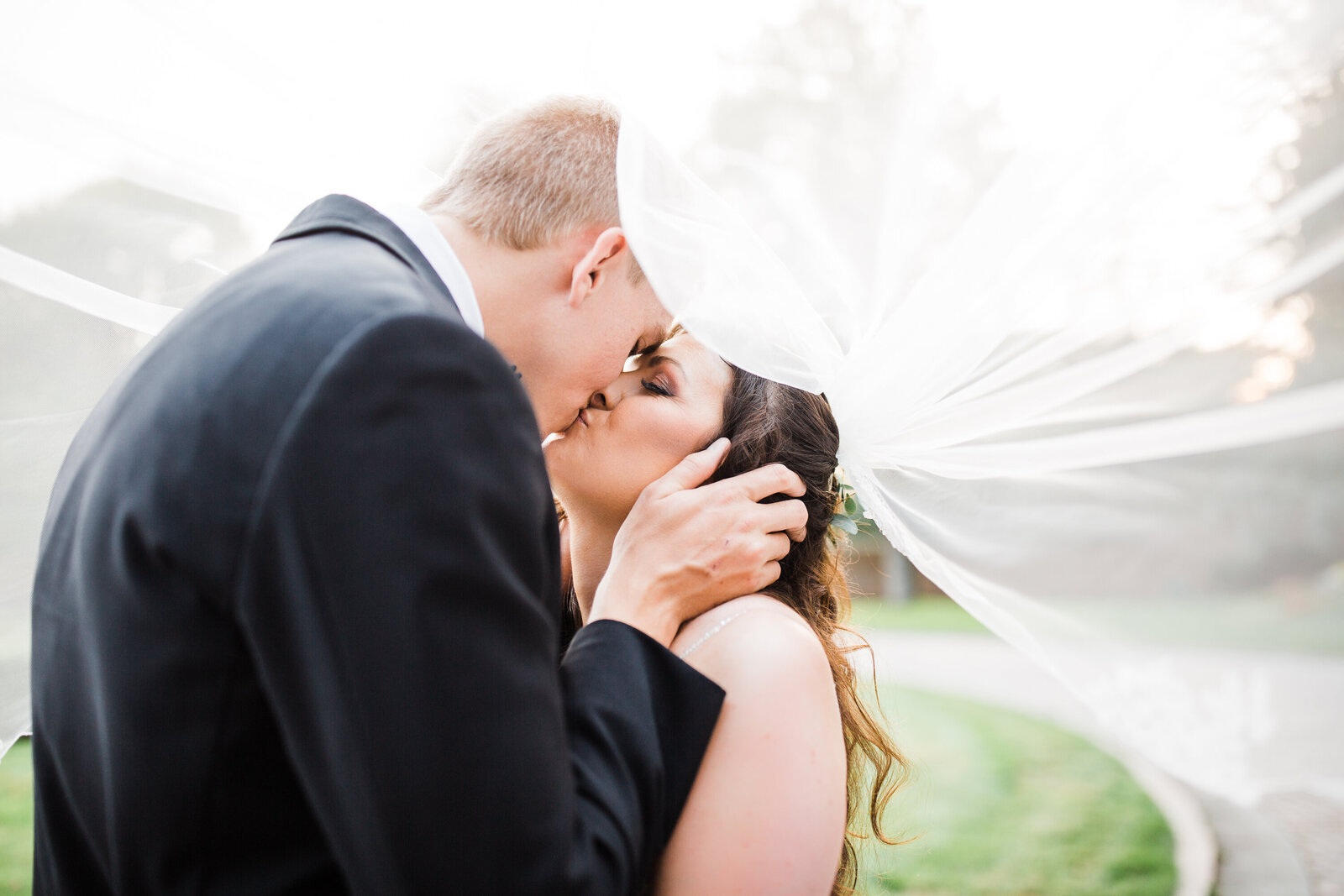Bride and Groom Sharing a kiss at their Michigan  wedding