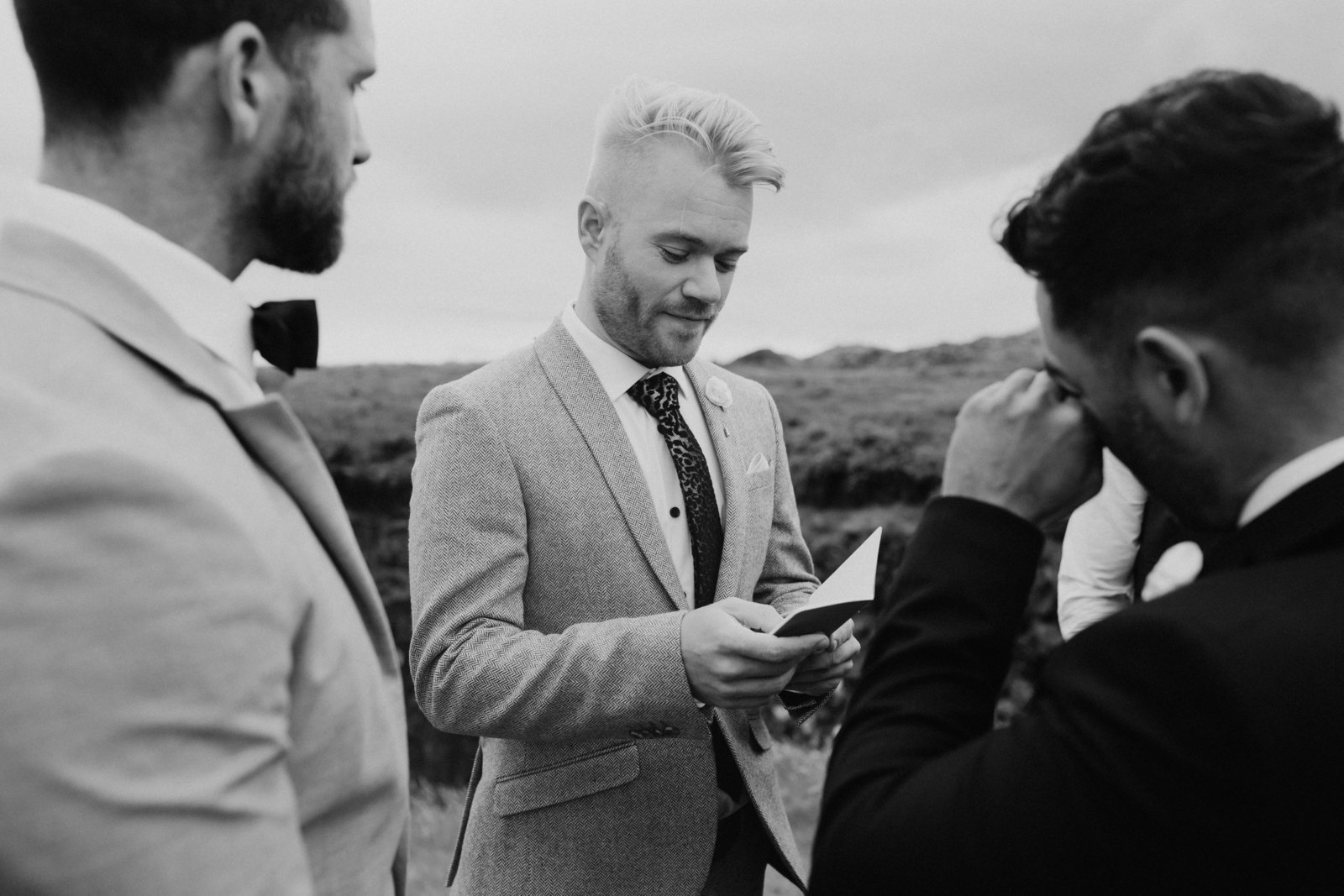 gay couple saying vows at their Iceland elopement