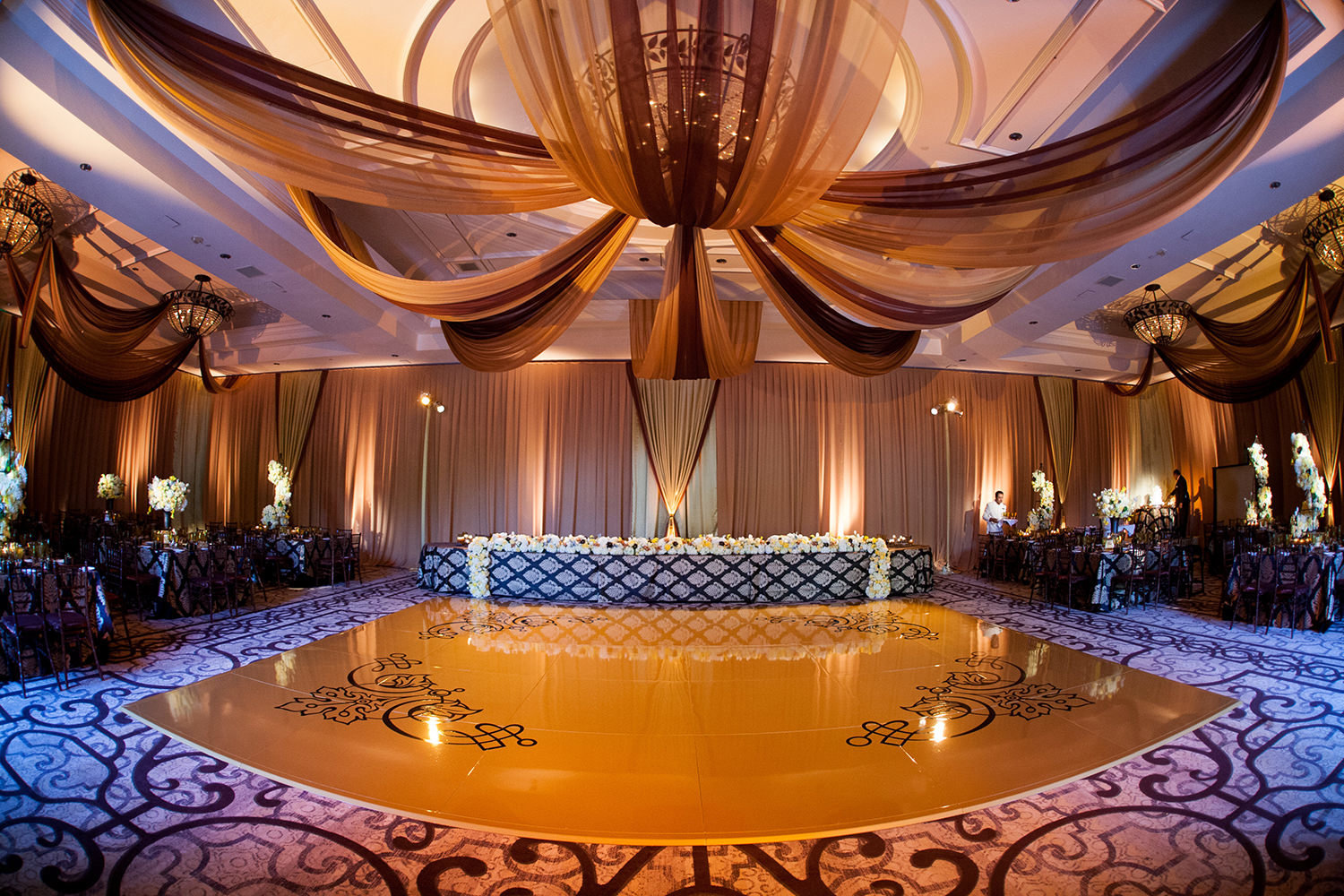Rich colors and uplighting set a stunning scene for this wedding reception