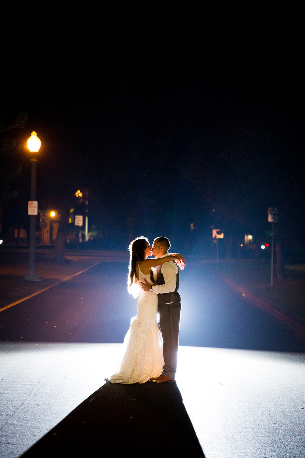 stunning night image with bride and groom at brick