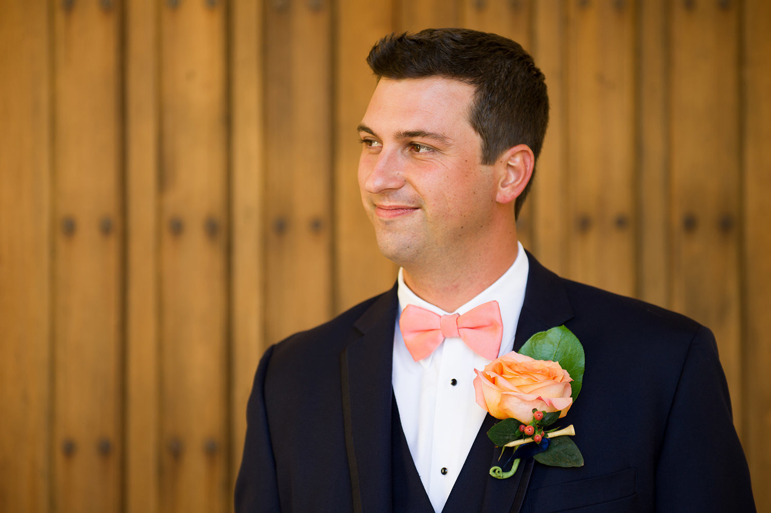 groom photo with peach flower