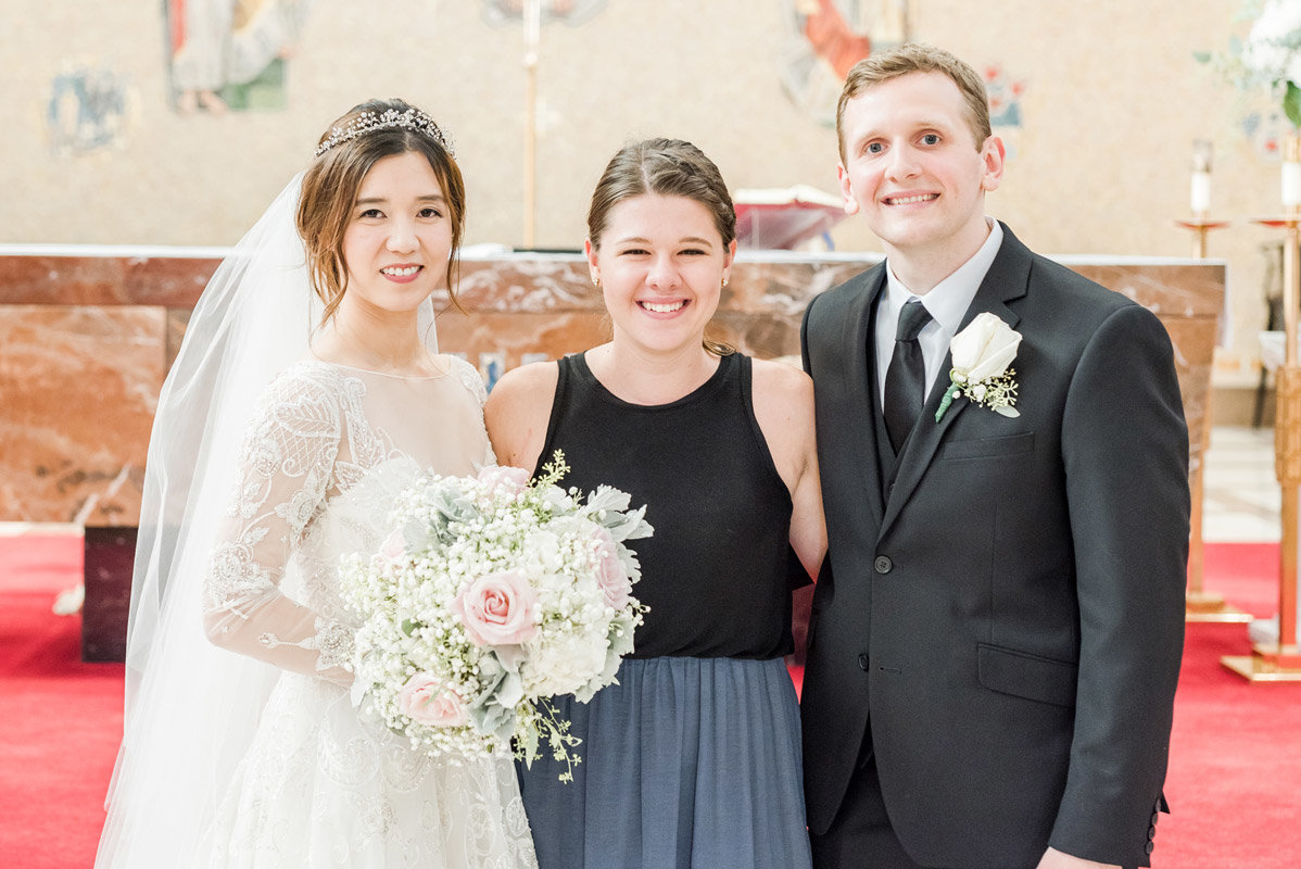 photo-of-the-photographer-with-the-bride-and-groom