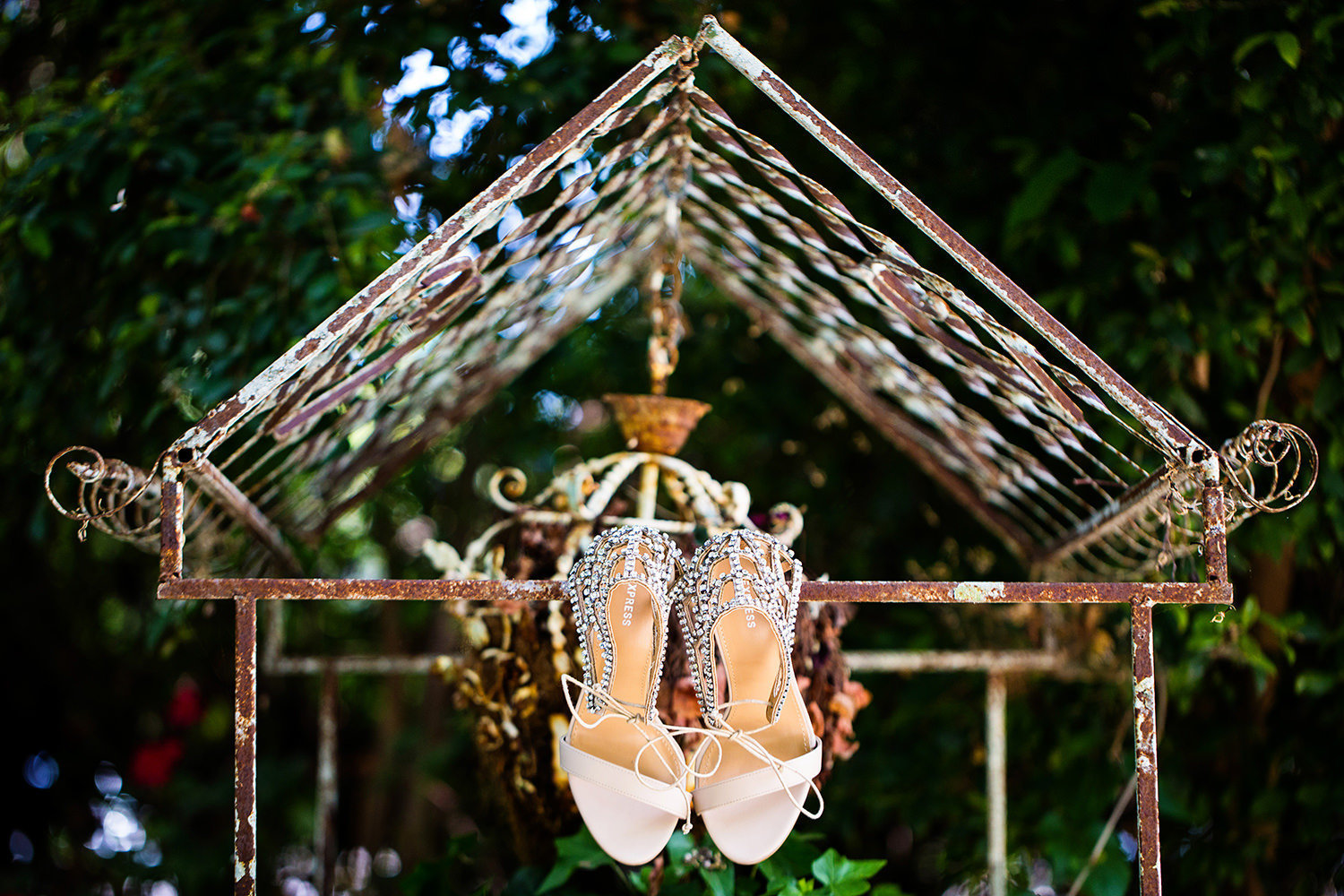Creative wedding shoe detail shot in a garden setting