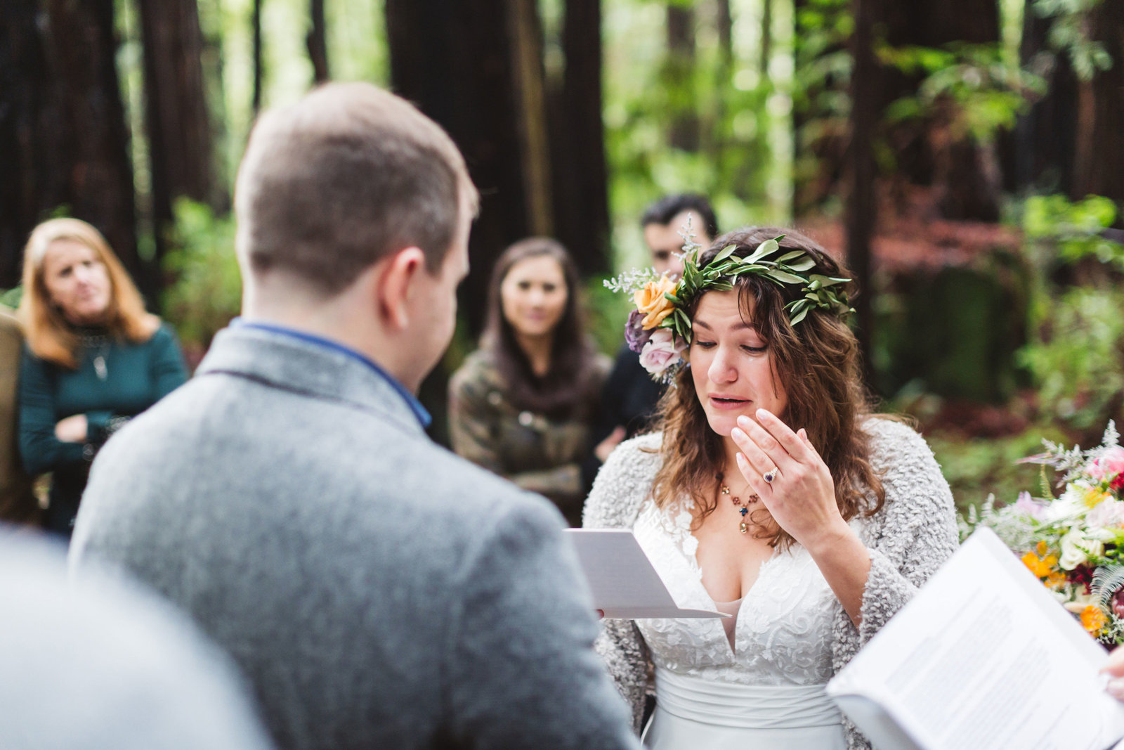 bride wipes away a tear at emotional wedding ceremony in santa cruz redwood forest