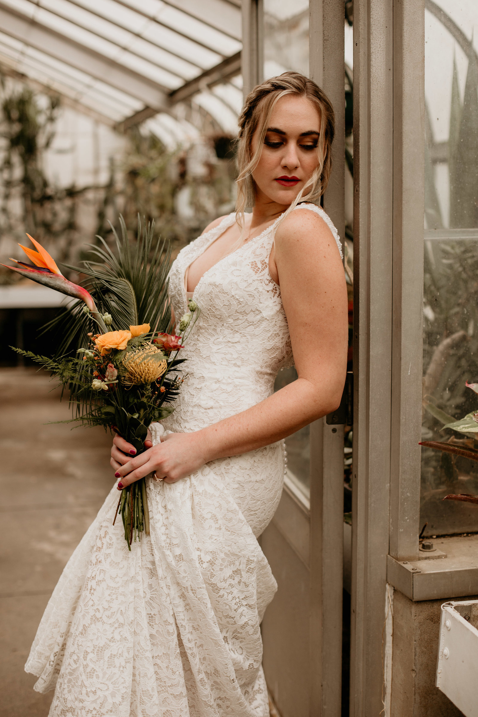 Bridal portrait in a greenhouse.