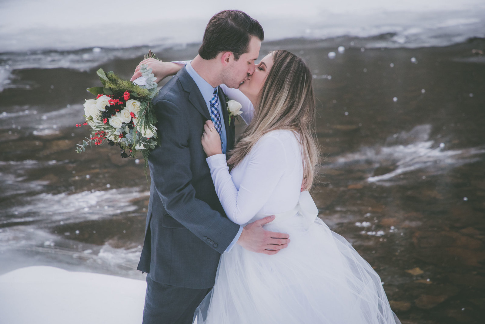 Couple kisses during their winter elopement in Upstate New York.