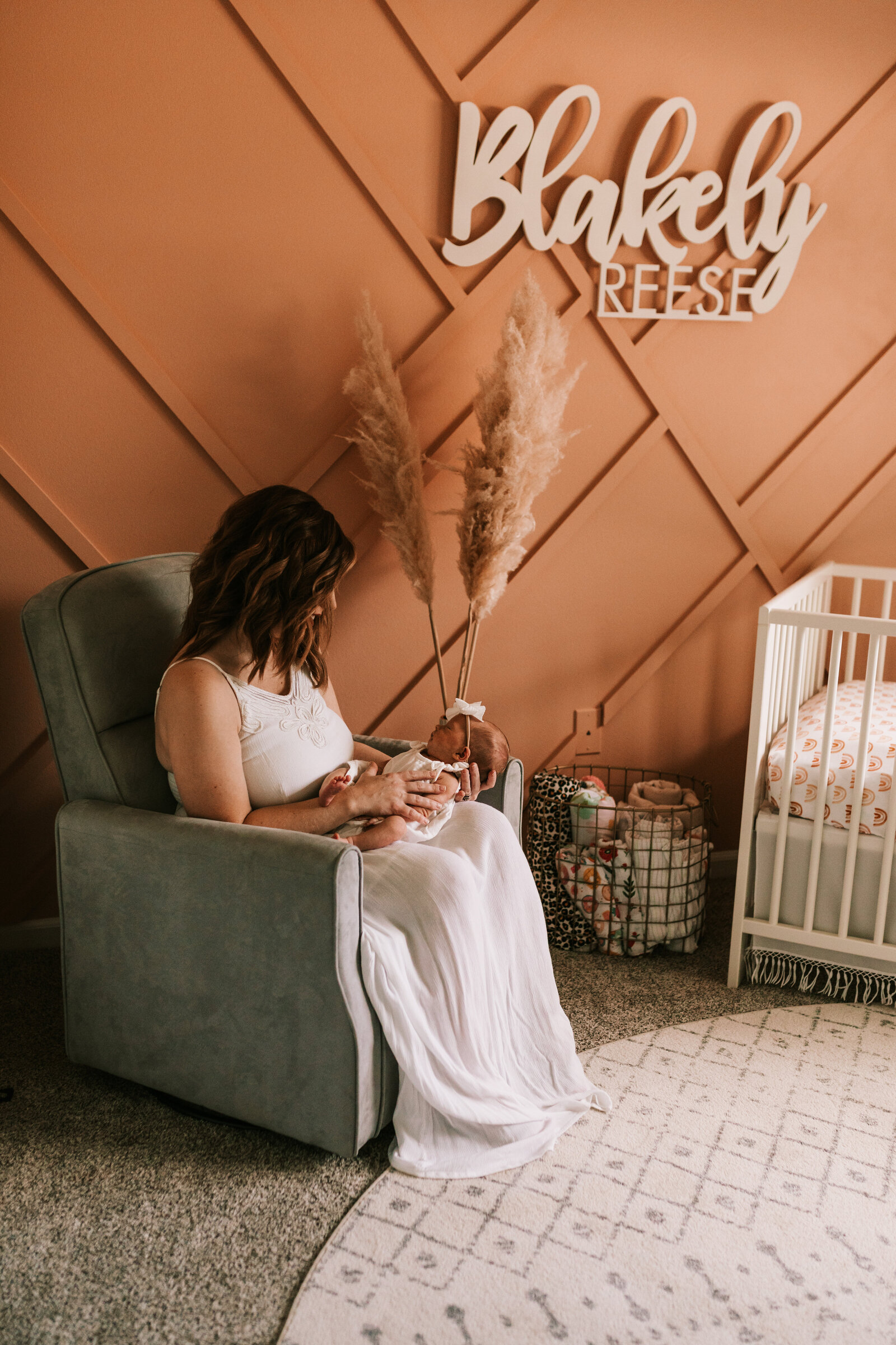 baby session with mom newborn in room with boho vibes