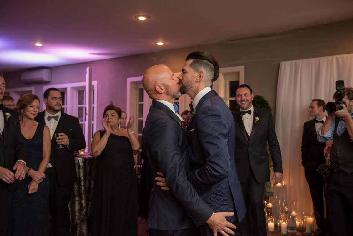 Brendan & Ryan kiss after their first dance during their wedding at Lord Thompson Manor